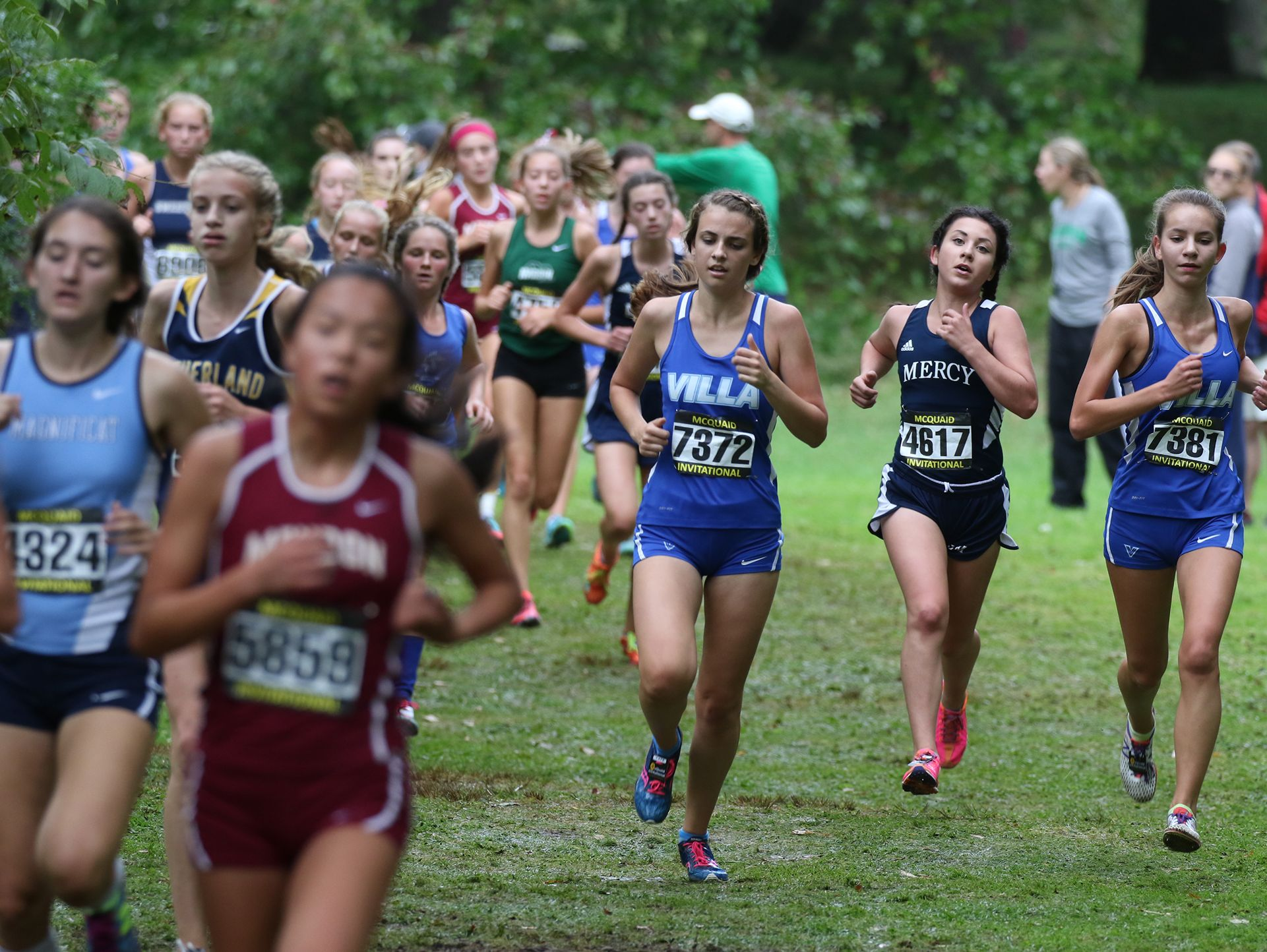 The Girls Seeded Class AA medium schools runners make their way through a wooded area on the last half of their race.