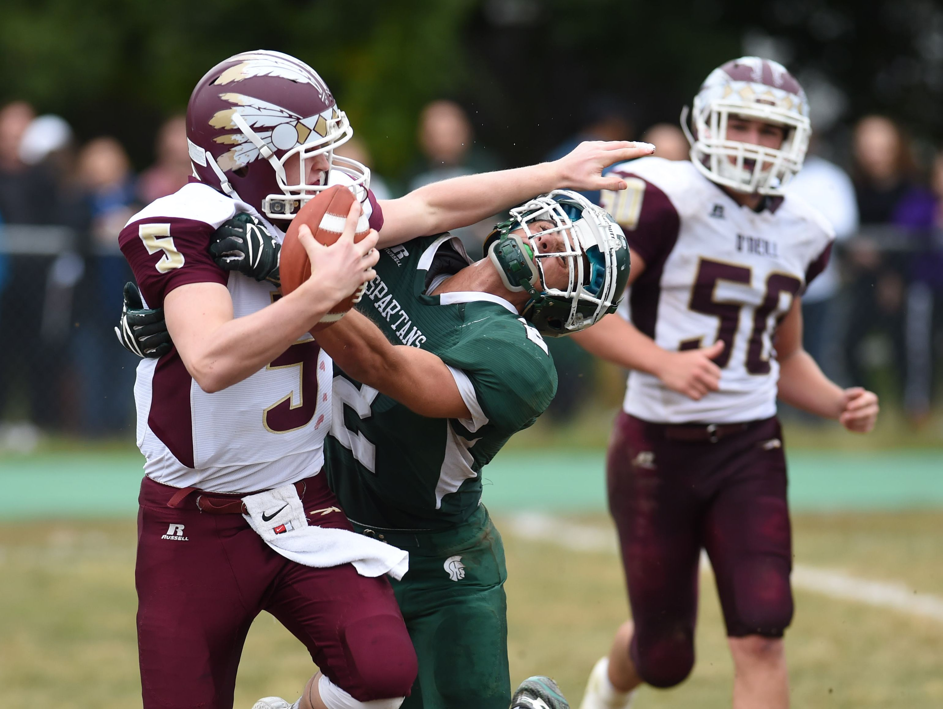 Spackenkill's Joseph Arcuri attempts to tackle O'Neill's, Luke Kilner during Saturday's game at Spackenkill.