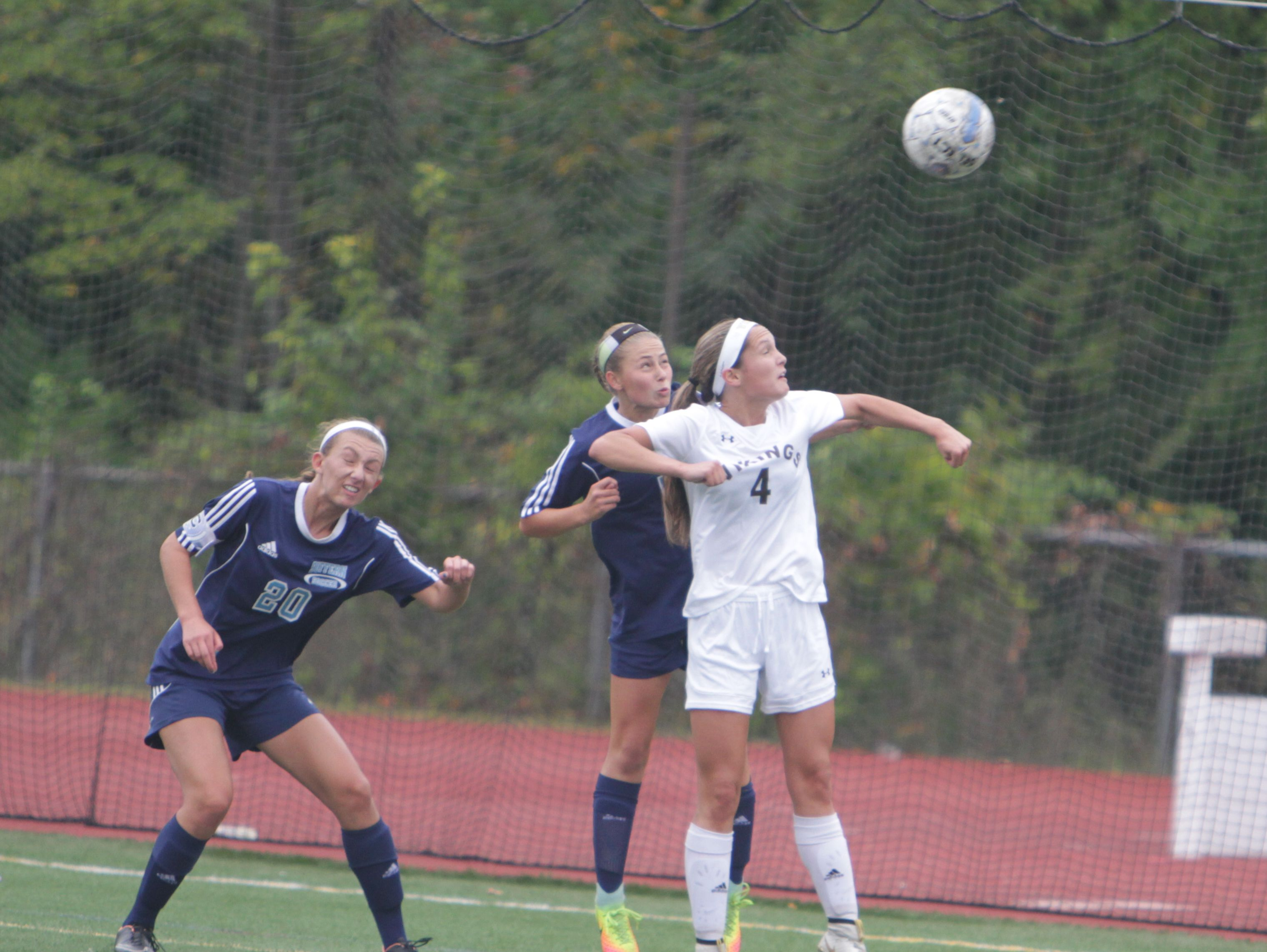 Clarkstown South's Fiona Cummings (4) and Suffern's Abby Bosco (middle) jump for a ball in the air, with Suffern's Jayne Goldman looking on, during a Section 1 girls soccer game between Clarkstown South and Suffern at Clarkstown South High School on Saturday, October 1st, 2016. Clarkstown South won 1-0 in overtime.