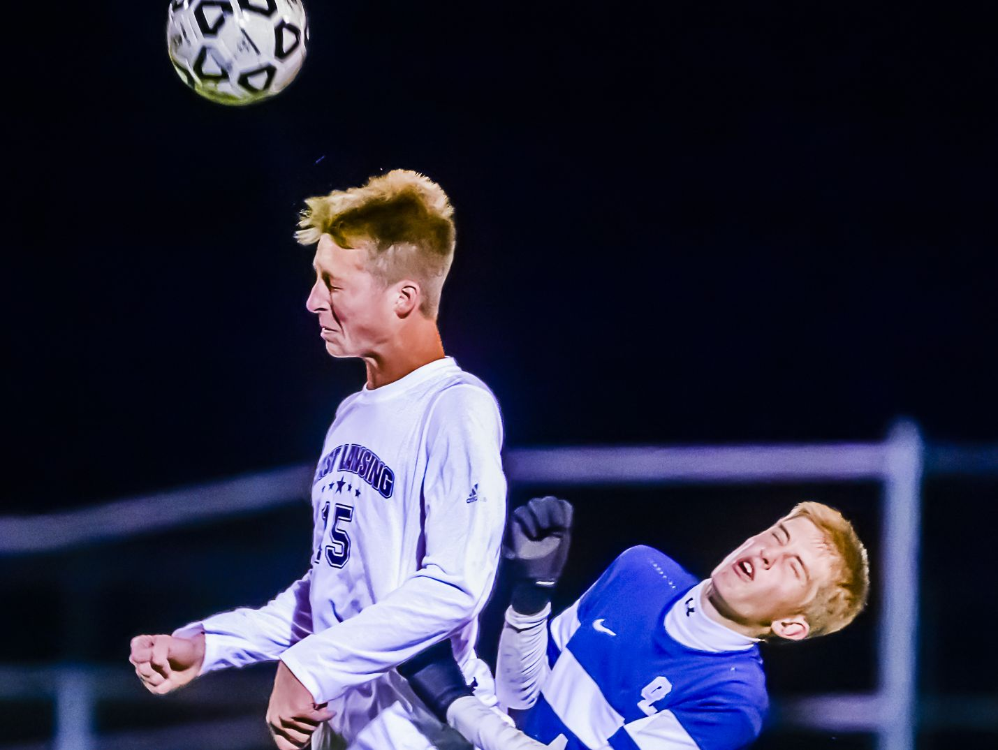 Grand Ledge's Aric Phinney, right, and East Lansing's Andrew Person collide during the CAAC Gold Cup final last year. Grand Ledge is the Gold Cup top seed and East Lansing is the No. 4 seed this fall.