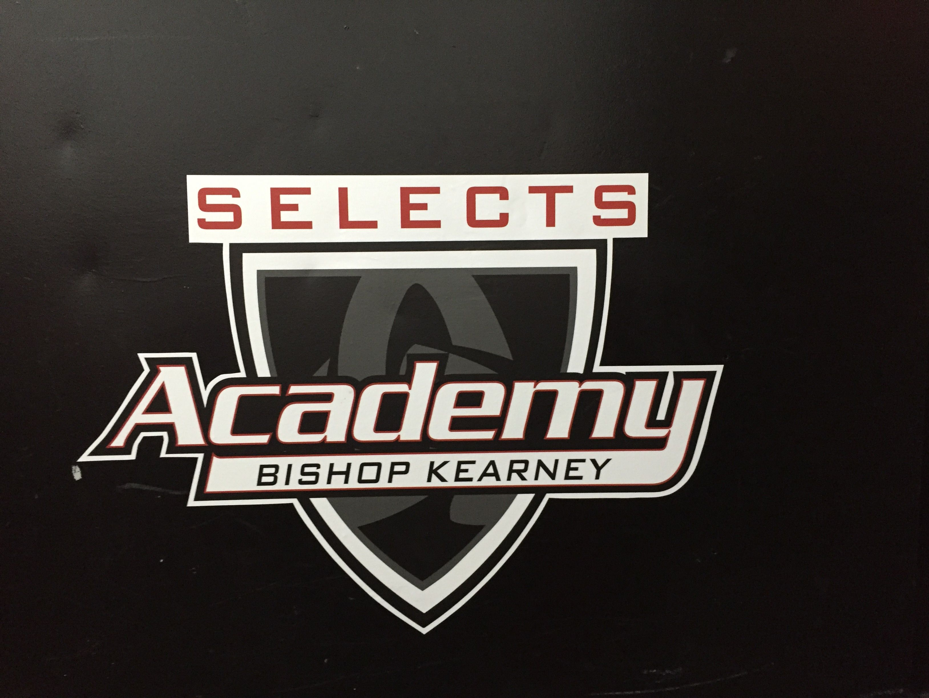 Kearney's school colors are blue, white and black, but the hockey team uses the logo and colors of Global Legacy Sports' Selects Academy for the girls hockey team, as shown on the locker room door at Bill Gray's Regional Iceplex.