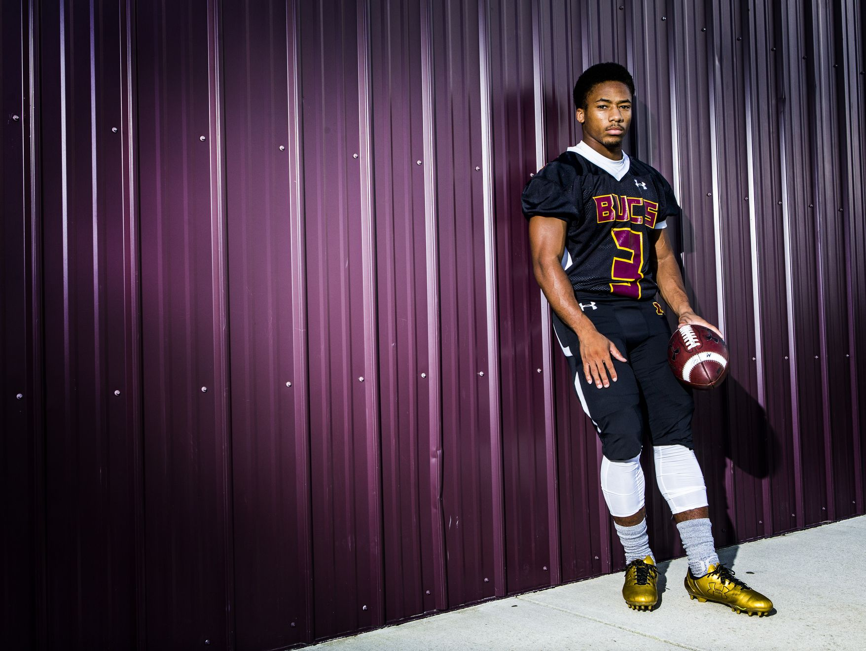 Milford High School running back David Bowman poses for a portrait at the Milford football stadium on Monday afternoon.