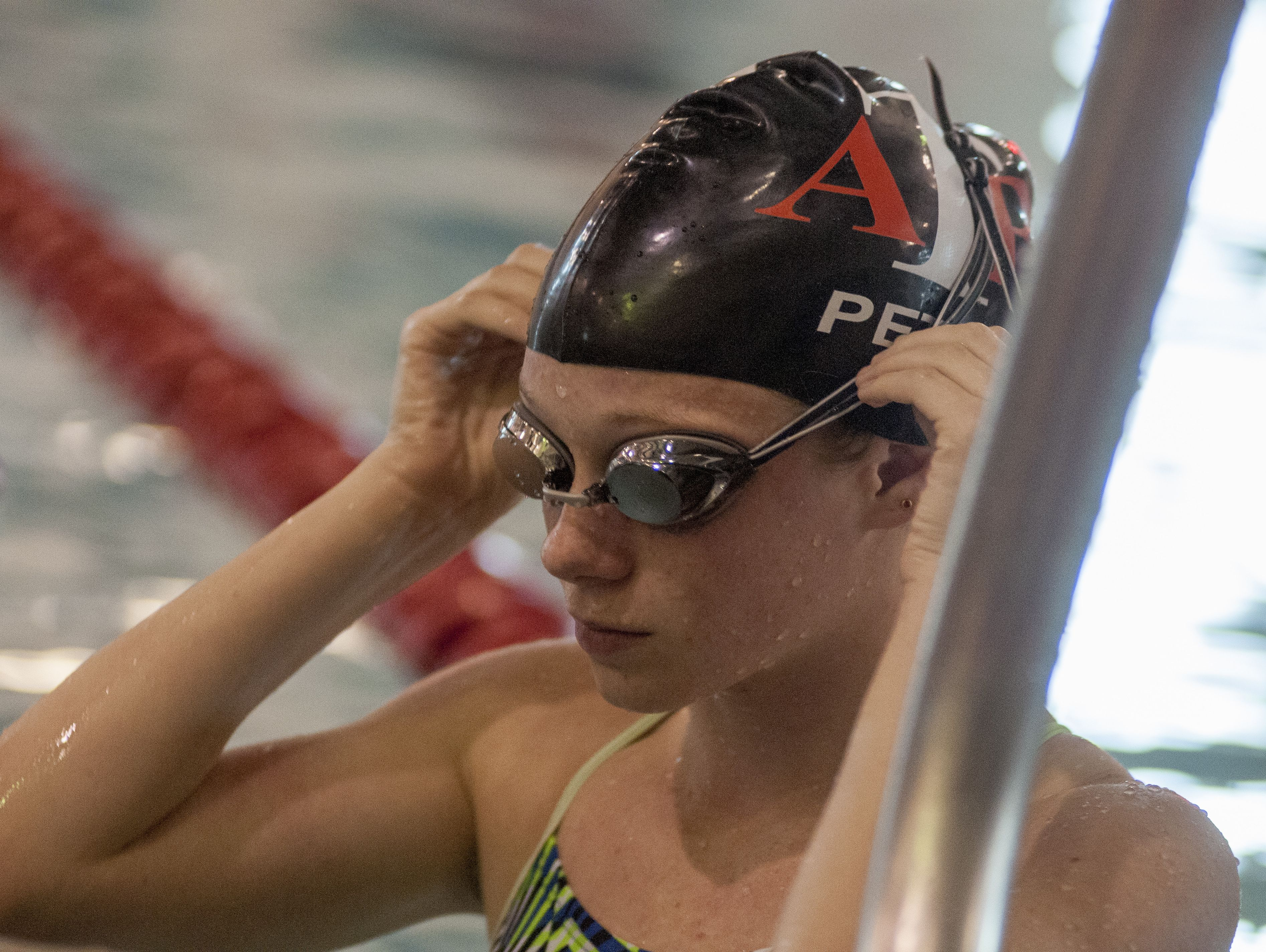 Riley Petit of Algonac adjusts her goggles Monday, Oct. 3, during swim practice at the Anchor Bay Aquatic Center.