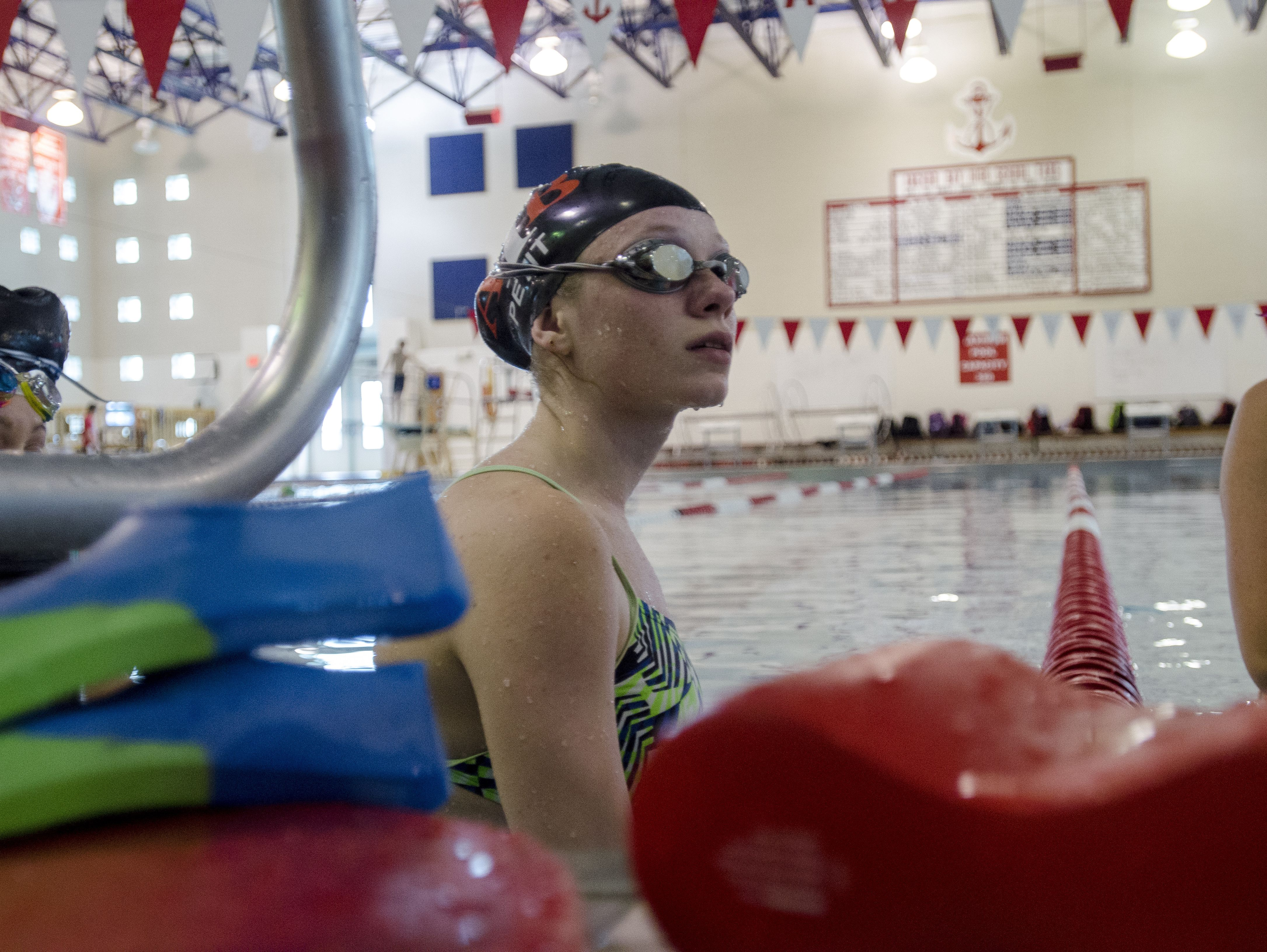 Riley Petit of Algonac rests in between laps Monday, Oct. 3, during swim practice at the Anchor Bay Aquatic Center.