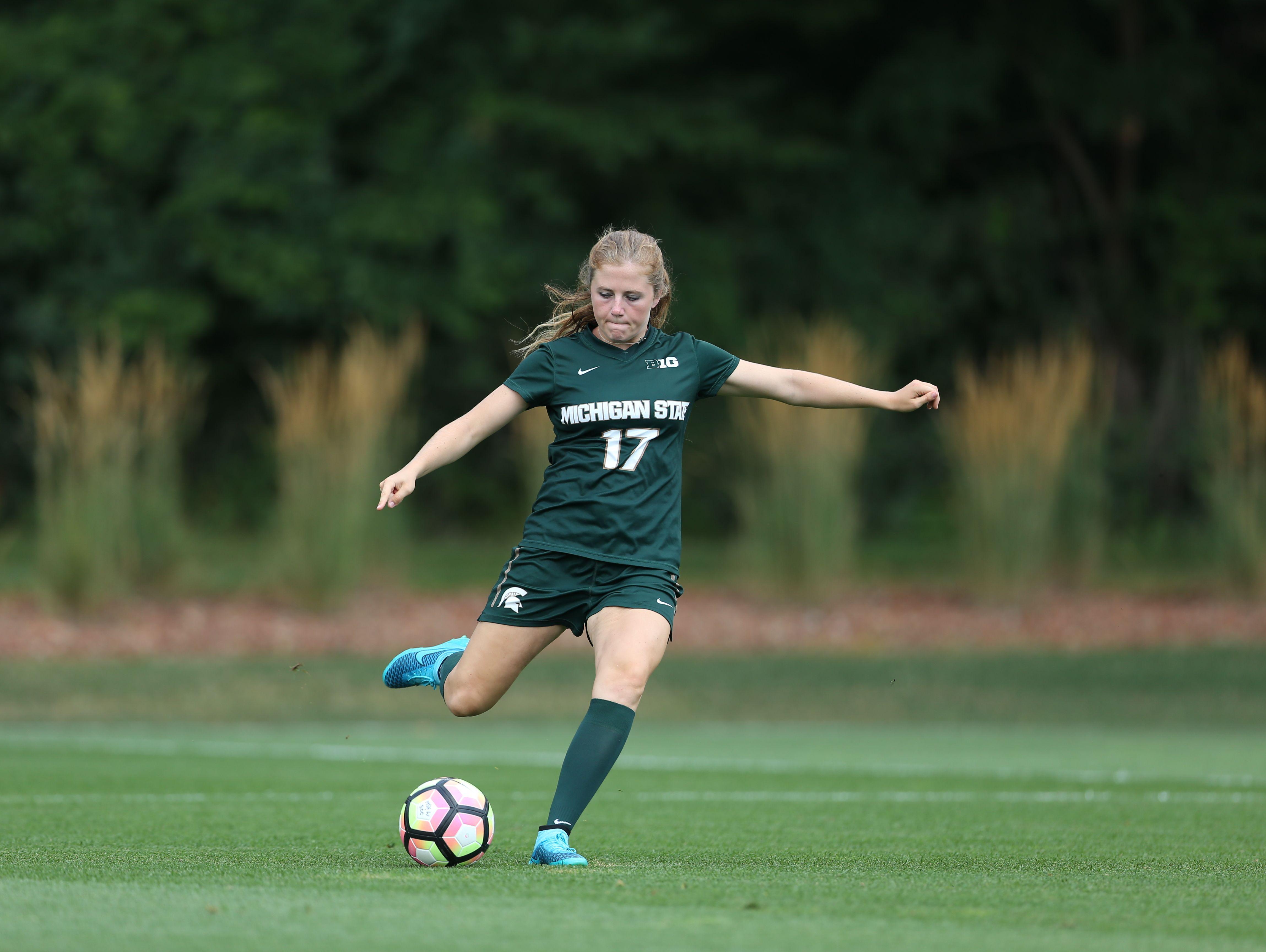 Port Huron Northern alumna Hannah Jones kicks the ball for Michigan State at DeMartin Soccer Stadium.