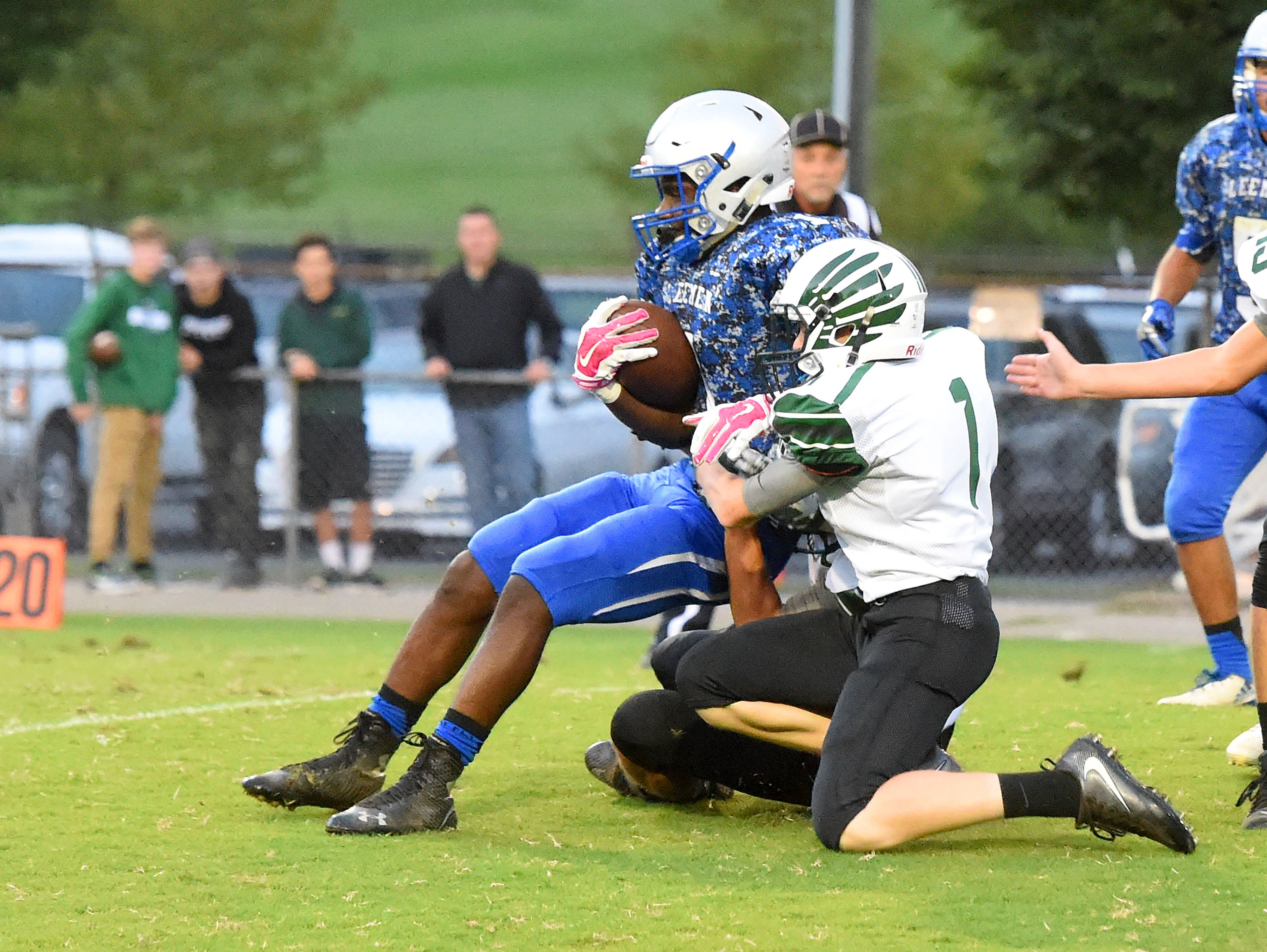 Robert E. Lee's Hurliq Williams is brought down by Broadway's Bryar Wheeler during a football game played in Staunton on Monday, Oct. 3, 2016.