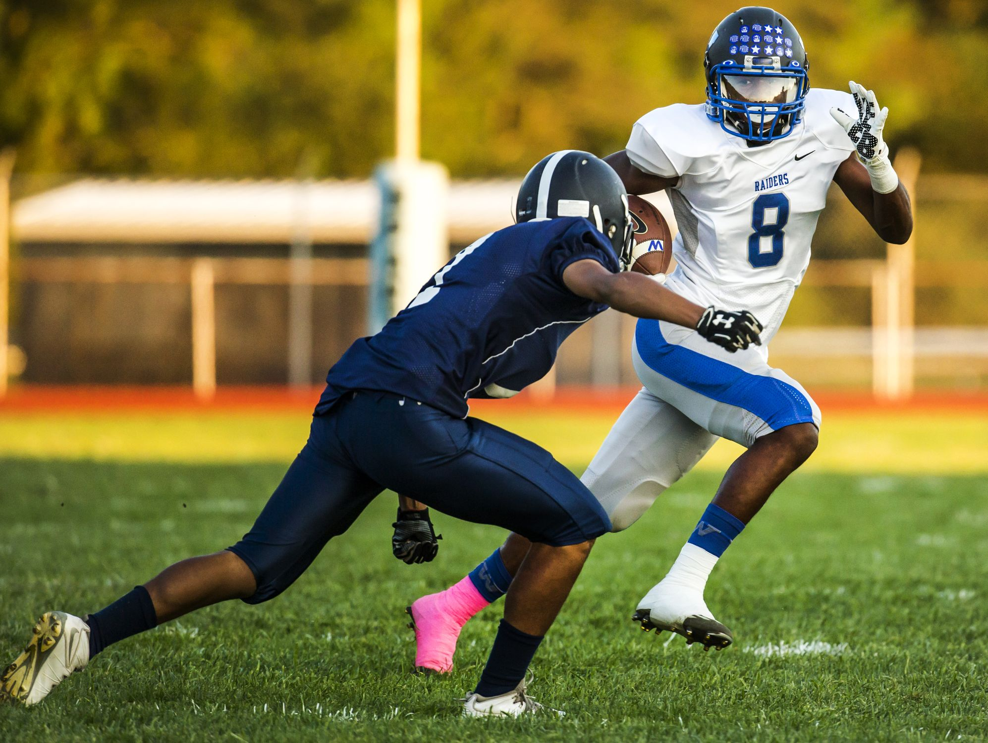 Woodbridge's Jamon Kane (No. 8) tries to shake Lake Forest's Jaysem Vazquez in the first quarter of Woodbridge's 32-0 win over Lake Forest at Lake Forest High School in Felton on Monday evening.