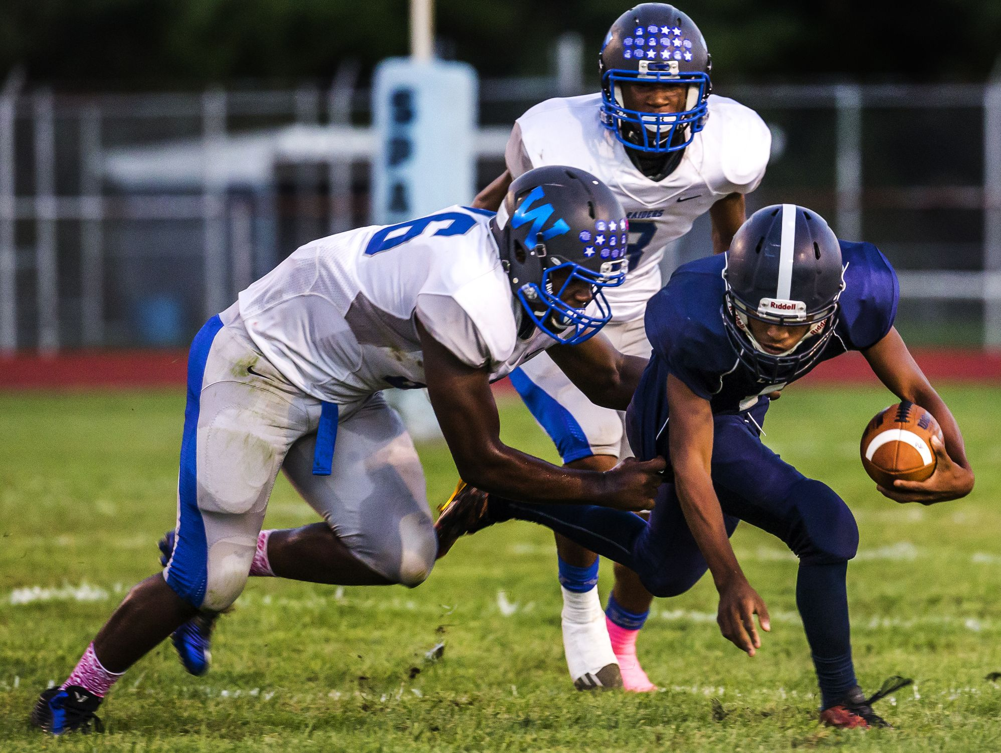 Lake Forest quarterback Xavier Daniels is sacked by Woodbridge's Shymere Vessels in the second quarter of Woodbridge's 32-0 win over Lake Forest at Lake Forest High School in Felton on Monday evening.