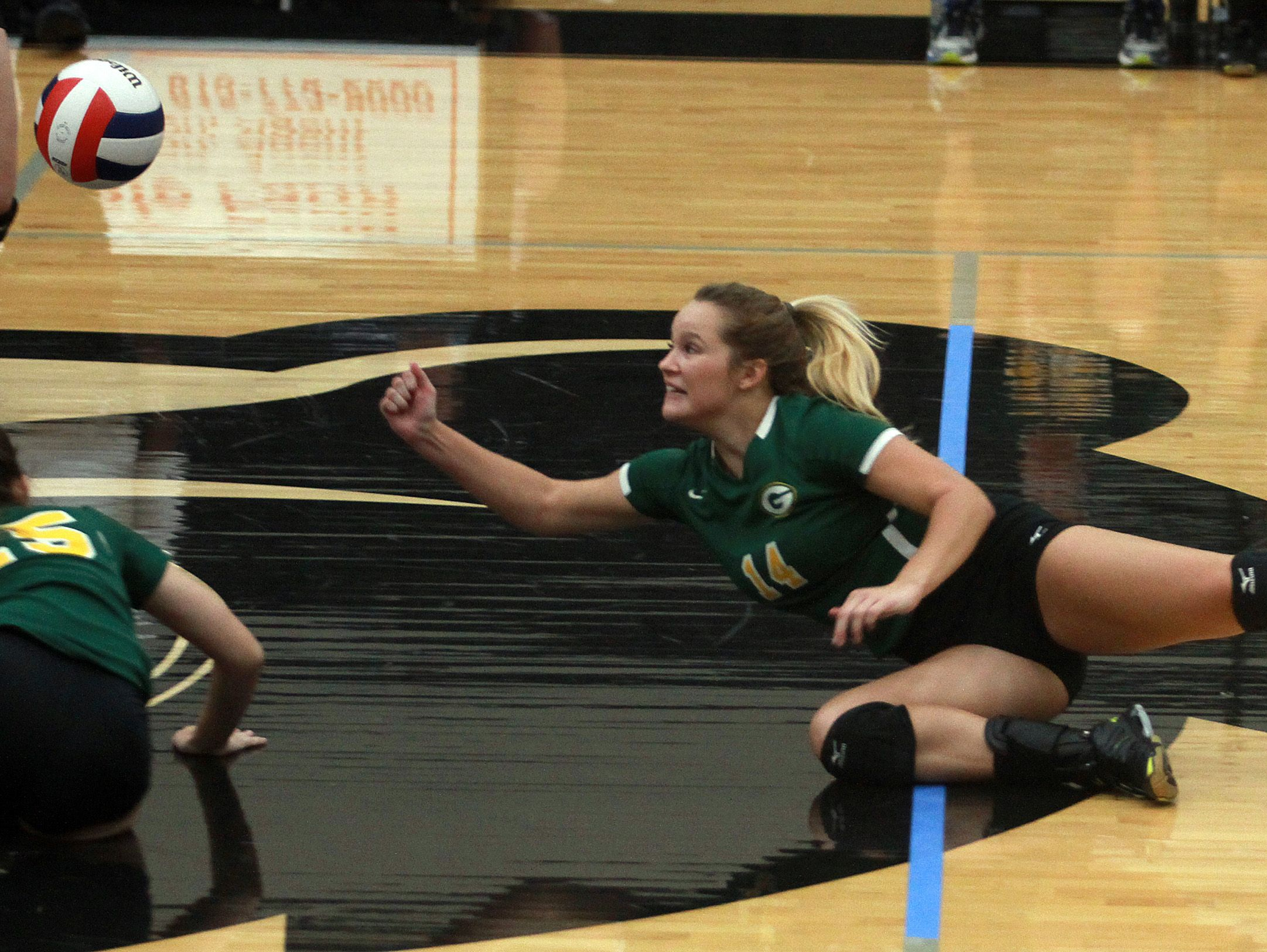 Gallatin's Haley Bowling dives to make a save against Mt. Juliet during Monday's District 9-AAA Tournament quarterfinals.