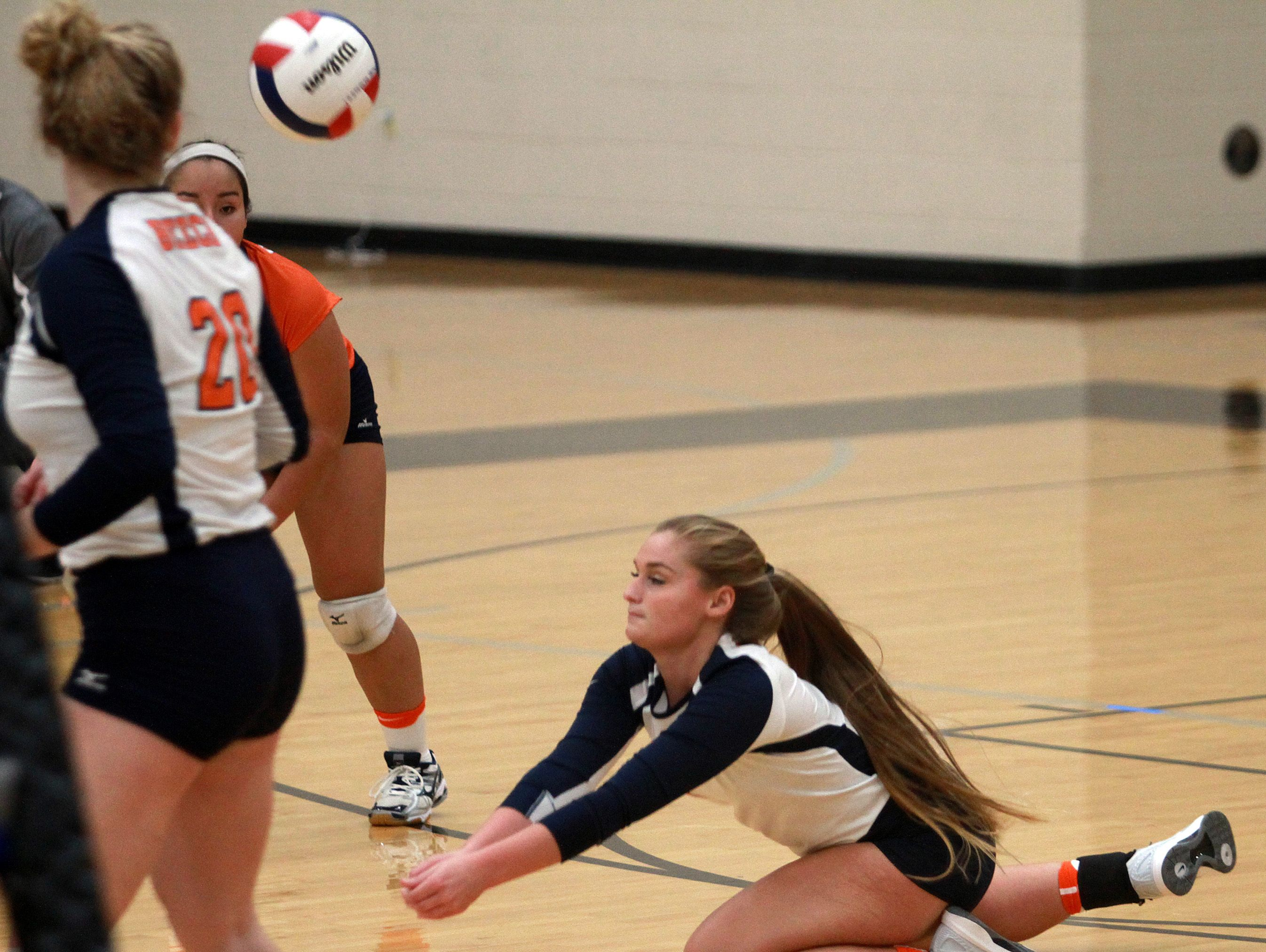 Beech's Chloee McDaniel digs for a ball against Wilson Central during Monday's District 9-AAA Tournament quarterfinals.