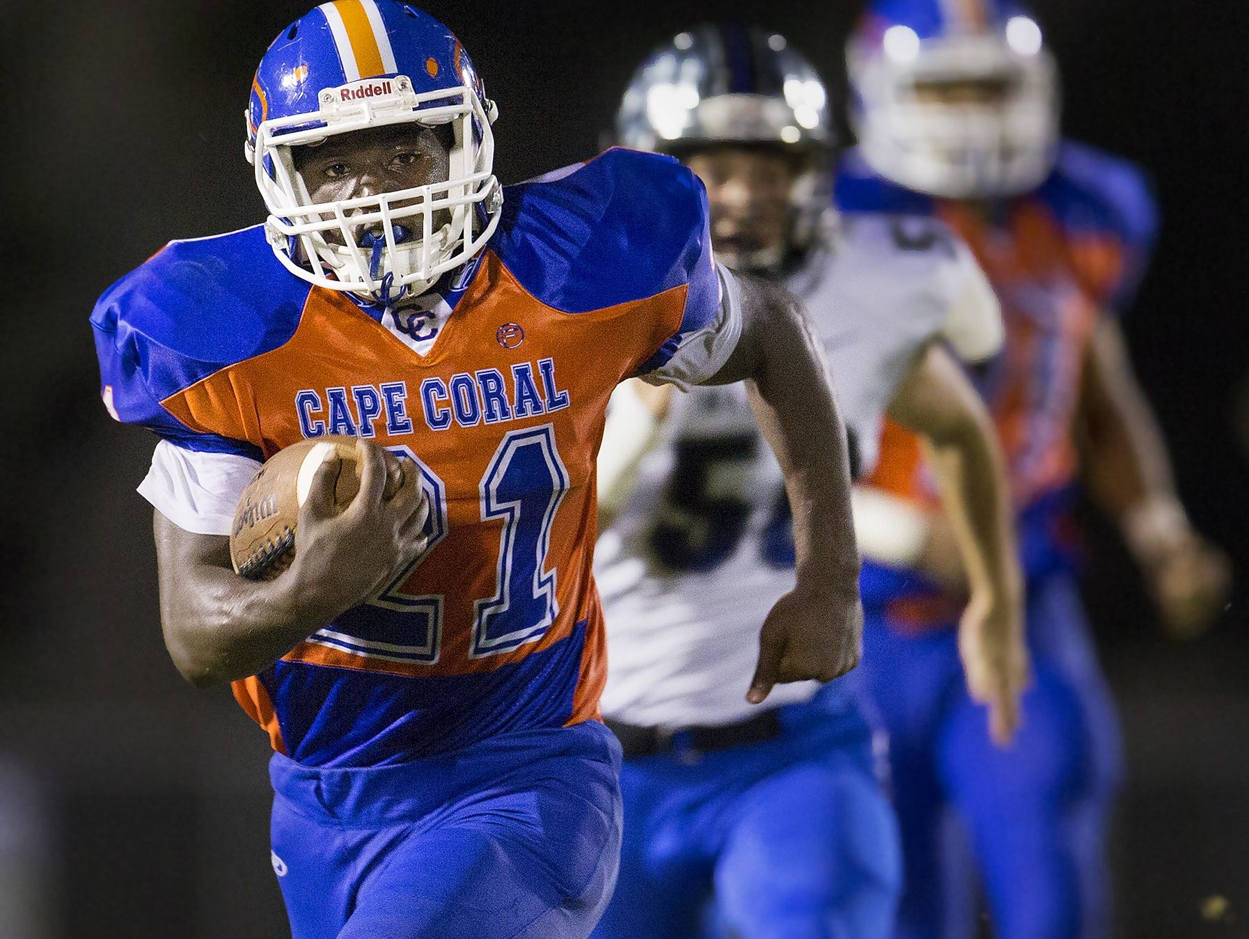 Cape Coral High School's Isaac Washington breaks free from Ida Baker defenders during the second quarter on Friday.