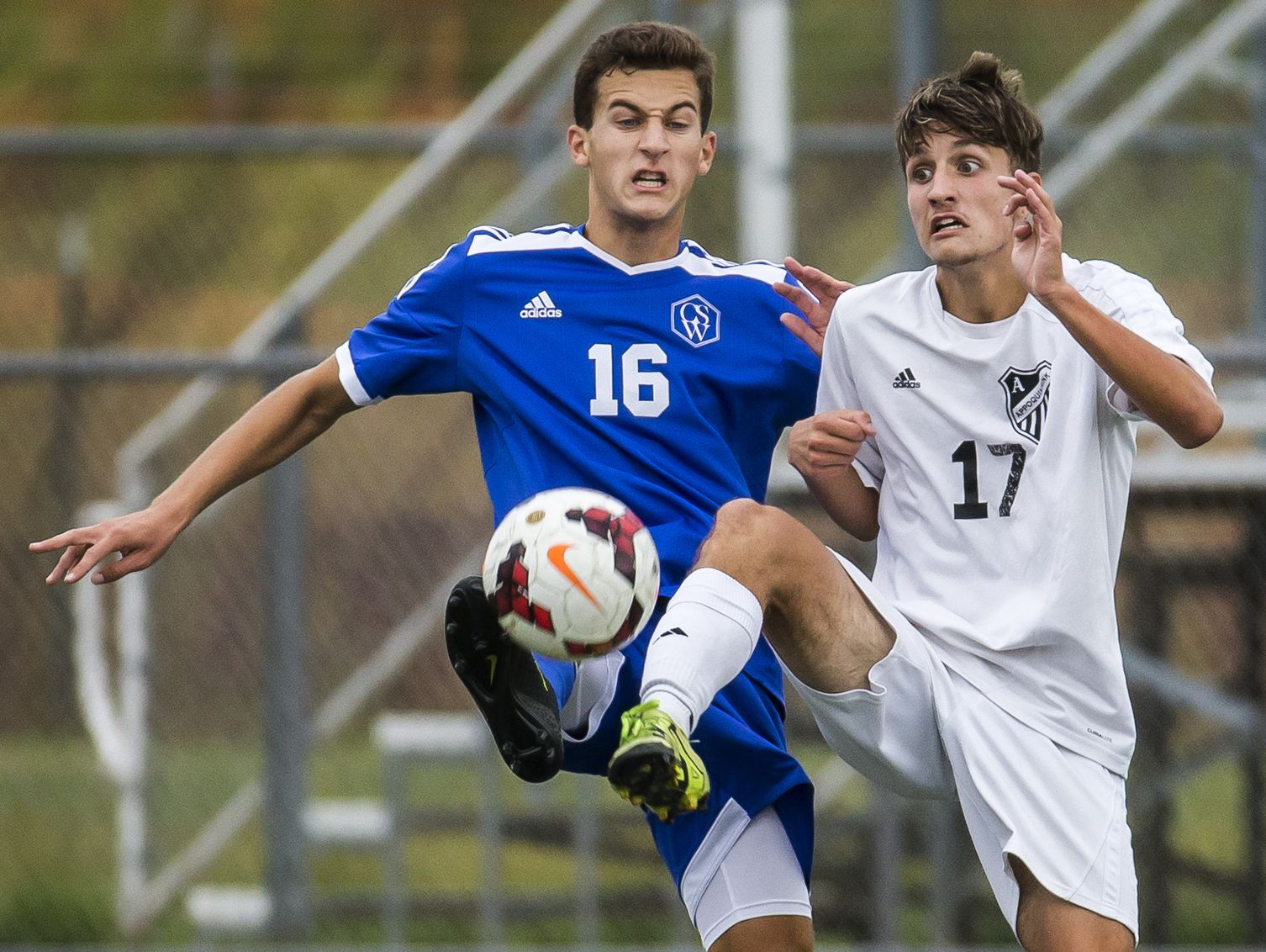 Charter's Andrew Amato (No. 16) and Appoquinimink's Seth Hubbard (No. 17) fight for the ball in the first half of Appoquinimink's 1-0 win over Charter School of Wilmington at Appoquinimink High School in Middletown on Tuesday afternoon.
