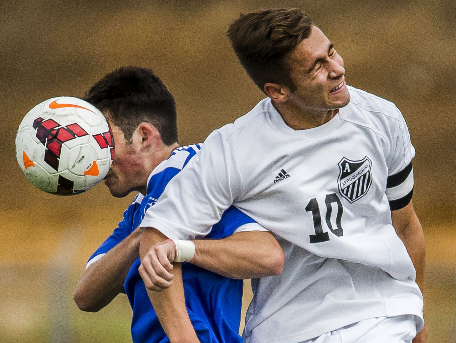 Appoquinimink's Joseph Scarpinato (right) heads the ball over Charter's Patrick O'Connor in the first half of Appoquinimink's 1-0 win over Charter School of Wilmington at Appoquinimink High School in Middletown on Tuesday afternoon.