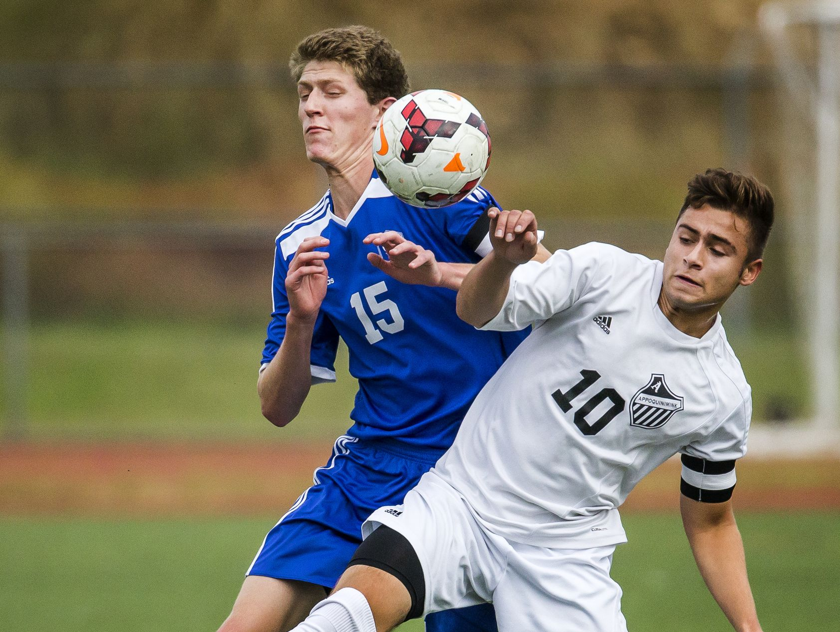 Appoquinimink's Joseph Scarpinato (No. 10) and Charter's Nolan Constantine (No. 15) fight for the ball in the first half of Appoquinimink's 1-0 win over Charter School of Wilmington at Appoquinimink High School in Middletown on Tuesday afternoon.