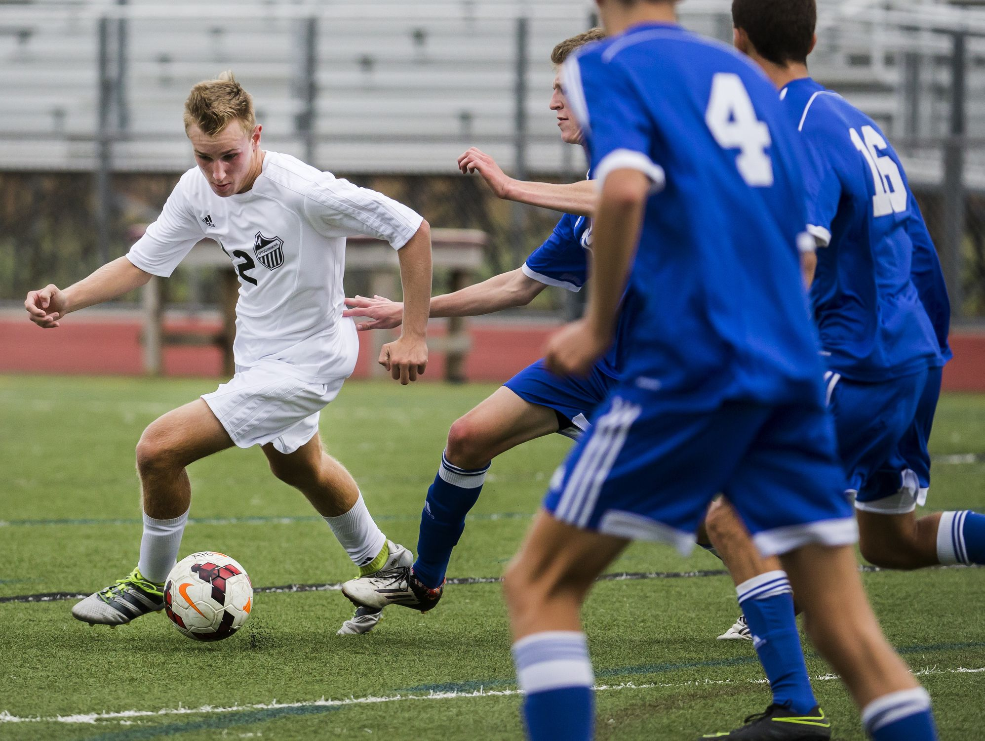Appoquinimink's Matthew Meadows works the ball through the box as he's pursued by a group of defenders in the second half of Appoquinimink's 1-0 win over Charter School of Wilmington at Appoquinimink High School in Middletown on Tuesday afternoon.