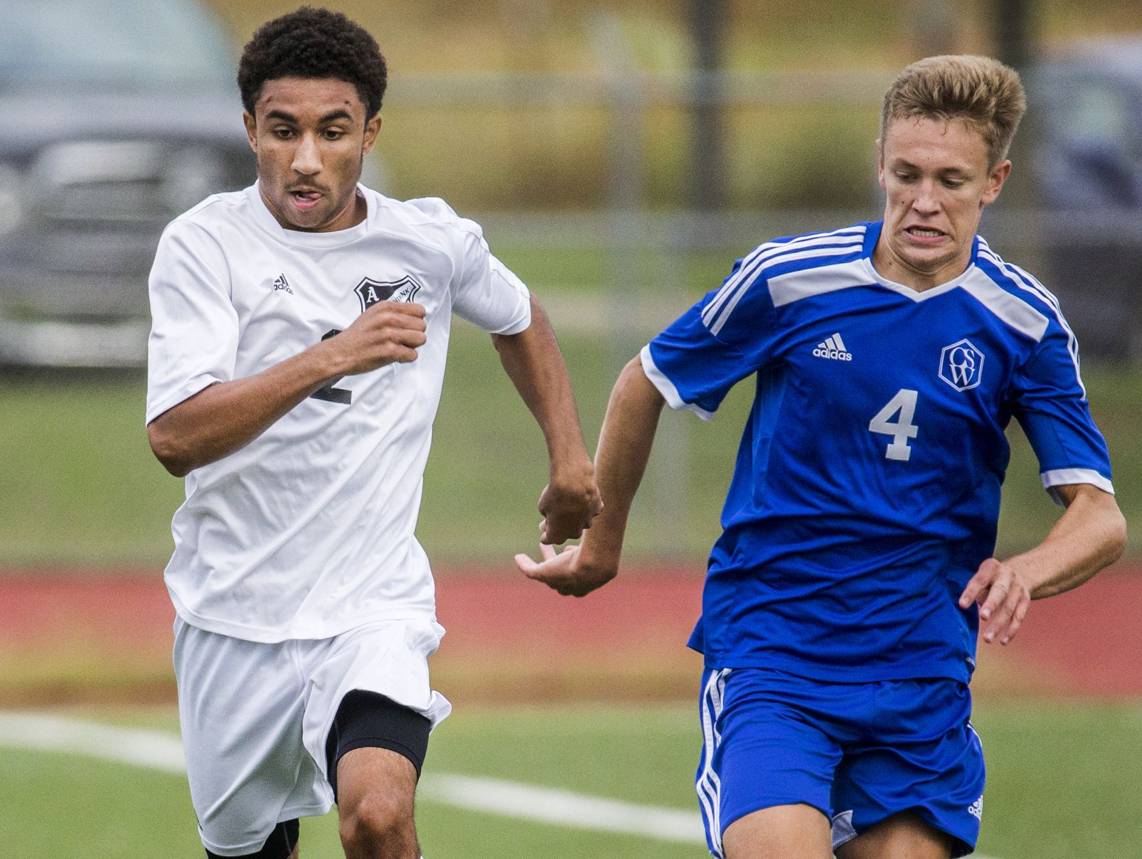 Appoquinimink's Derek Fisher (left) chases the ball down the sideline with Charter's Jacob Ogrodnik (right) in the second half of Appoquinimink's 1-0 win over Charter School of Wilmington at Appoquinimink High School in Middletown on Tuesday afternoon.