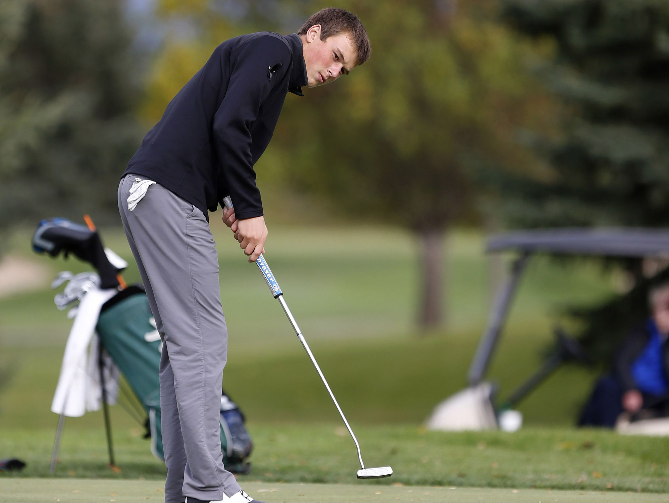 Will Grevlos, of Sioux Falls Washington, watches his putt on the 12th hole at Moccasin Creek Country Club in Aberdeen during Tuesday's round of the South Dakota Class AA golf tournament.