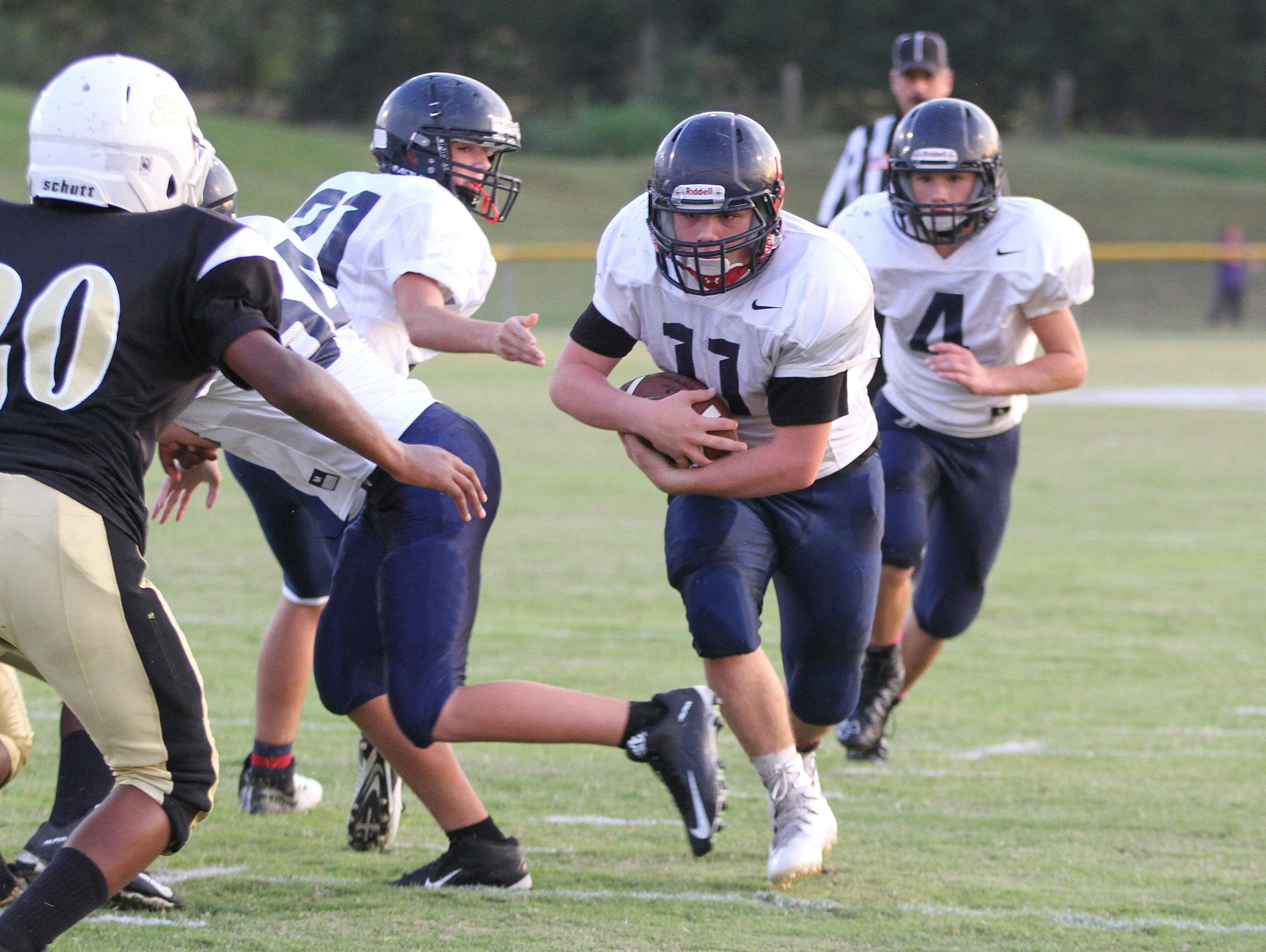 Jacdson Mapes scored Heritage's first touchdown in the Patriots 22-8 victory over Springfield.