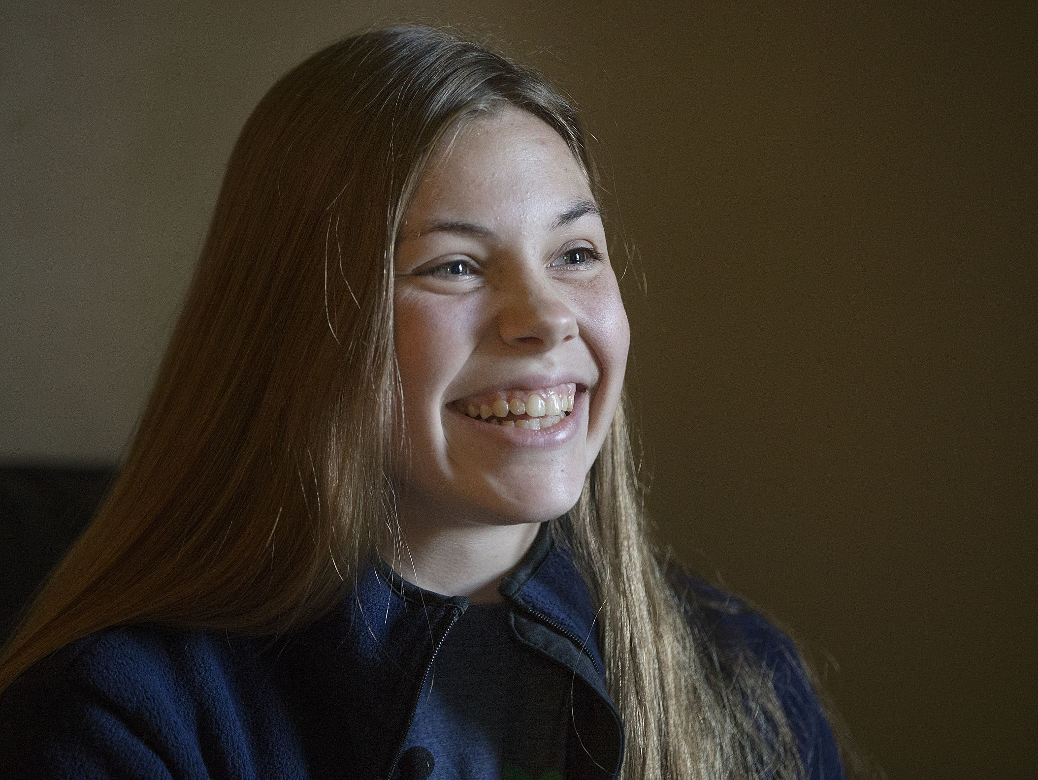Olivia Kavanaugh, 18, shares her perspective on her sister Caroline's experience living with a brain tumor, and how Caroline's positive spirit inspires her, at her family's south side home, Tuesday, September 27, 2016.