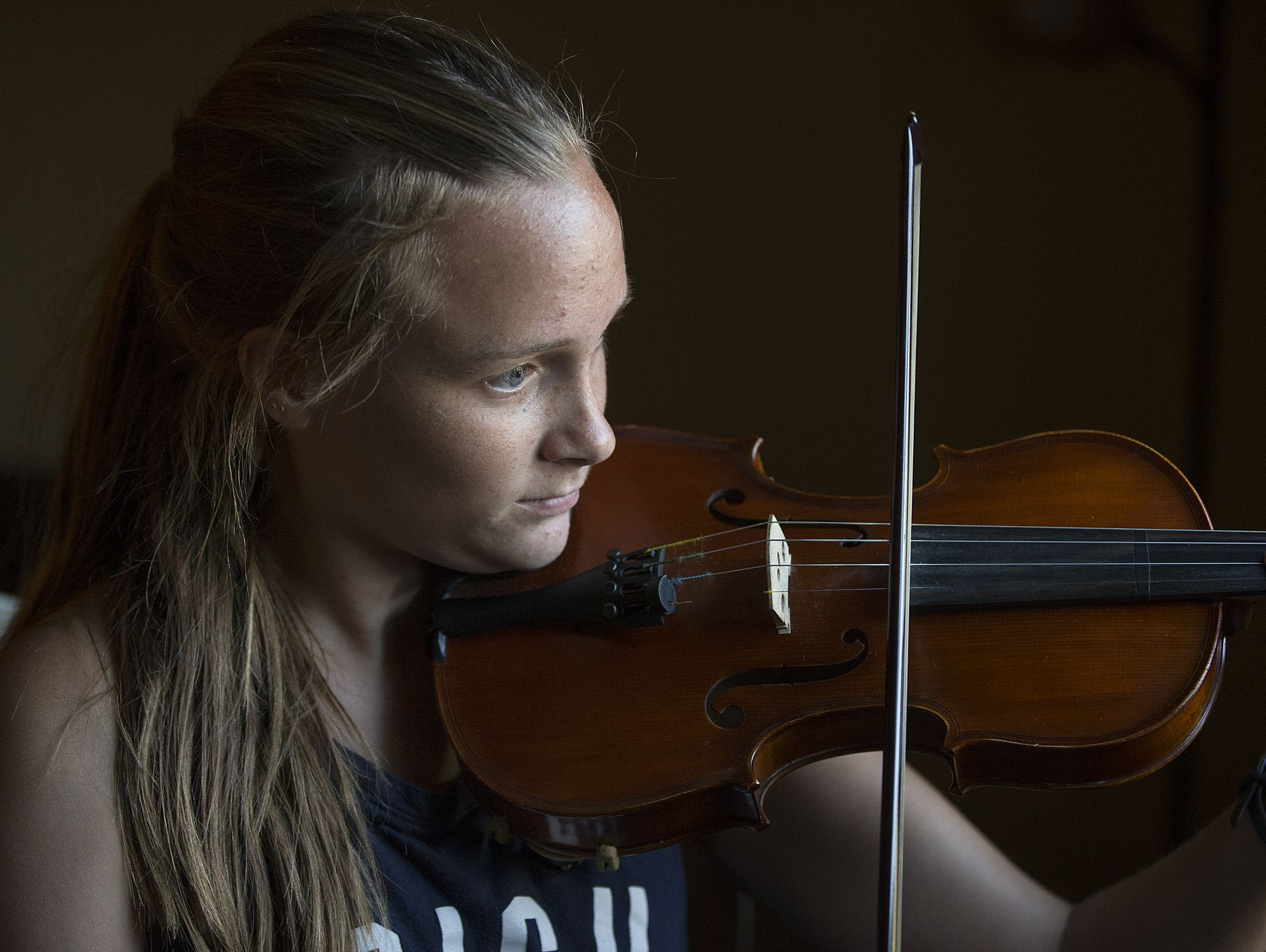Caroline Kavanaugh plays a song on violin for a portrait at her family's south side home, Tuesday, September 27, 2016. Despite the challenge of living with a brain tumor since her diagnosis in fourth grade, Kavanaugh stays involved in her many passions. The Perry Meridian junior is a member of chamber orchestra, S.R.O. choir, cross country, National Honor Society, Best Buddies Indiana, vice president of Fellowship of Christian Athletes and junior class representative of Perry Meridian key club.