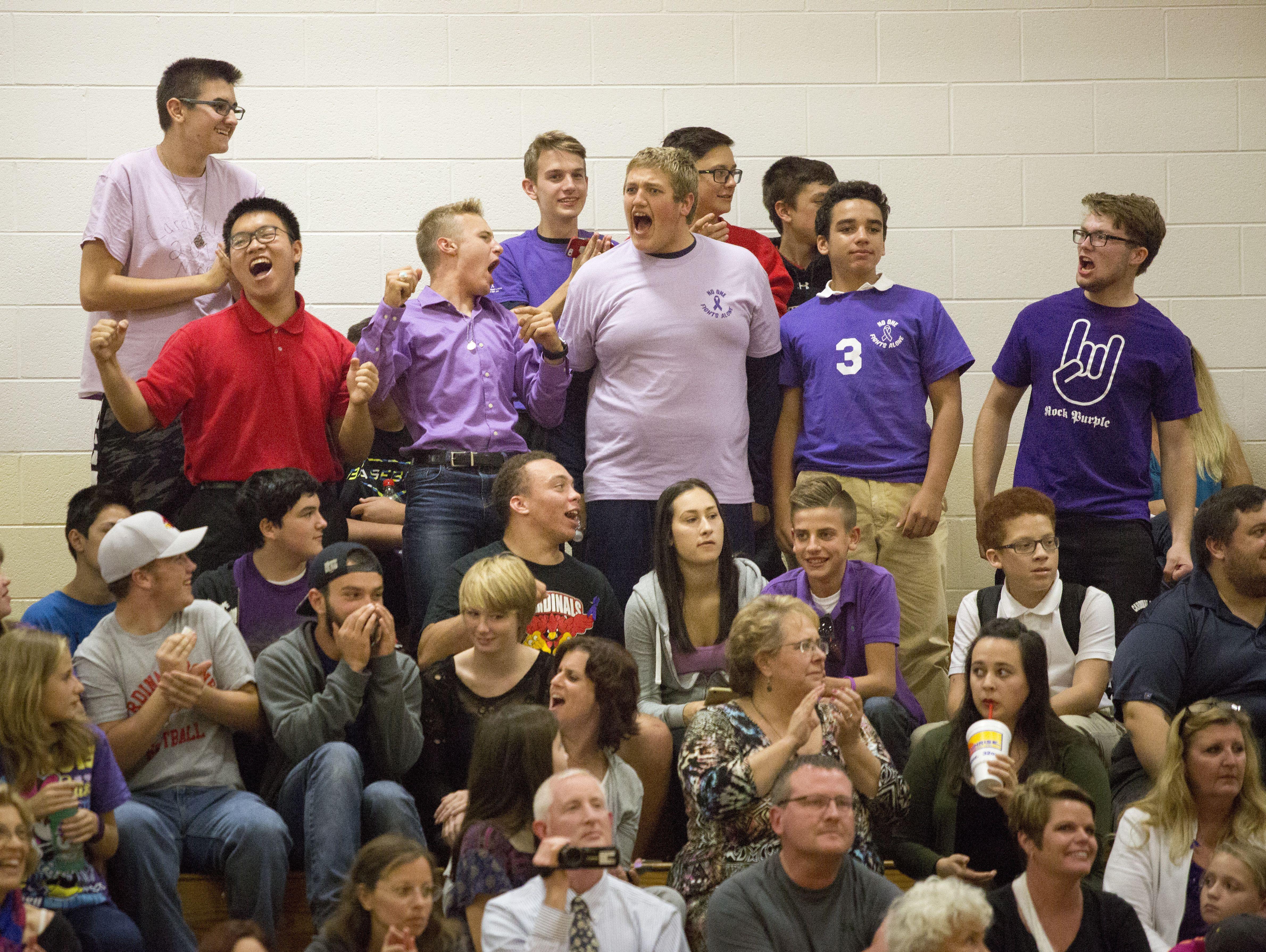 Cardinal Mooney fans cheer during a volleyball game Wednesday, Oct. 5, 2016 at Cardinal Mooney High School.