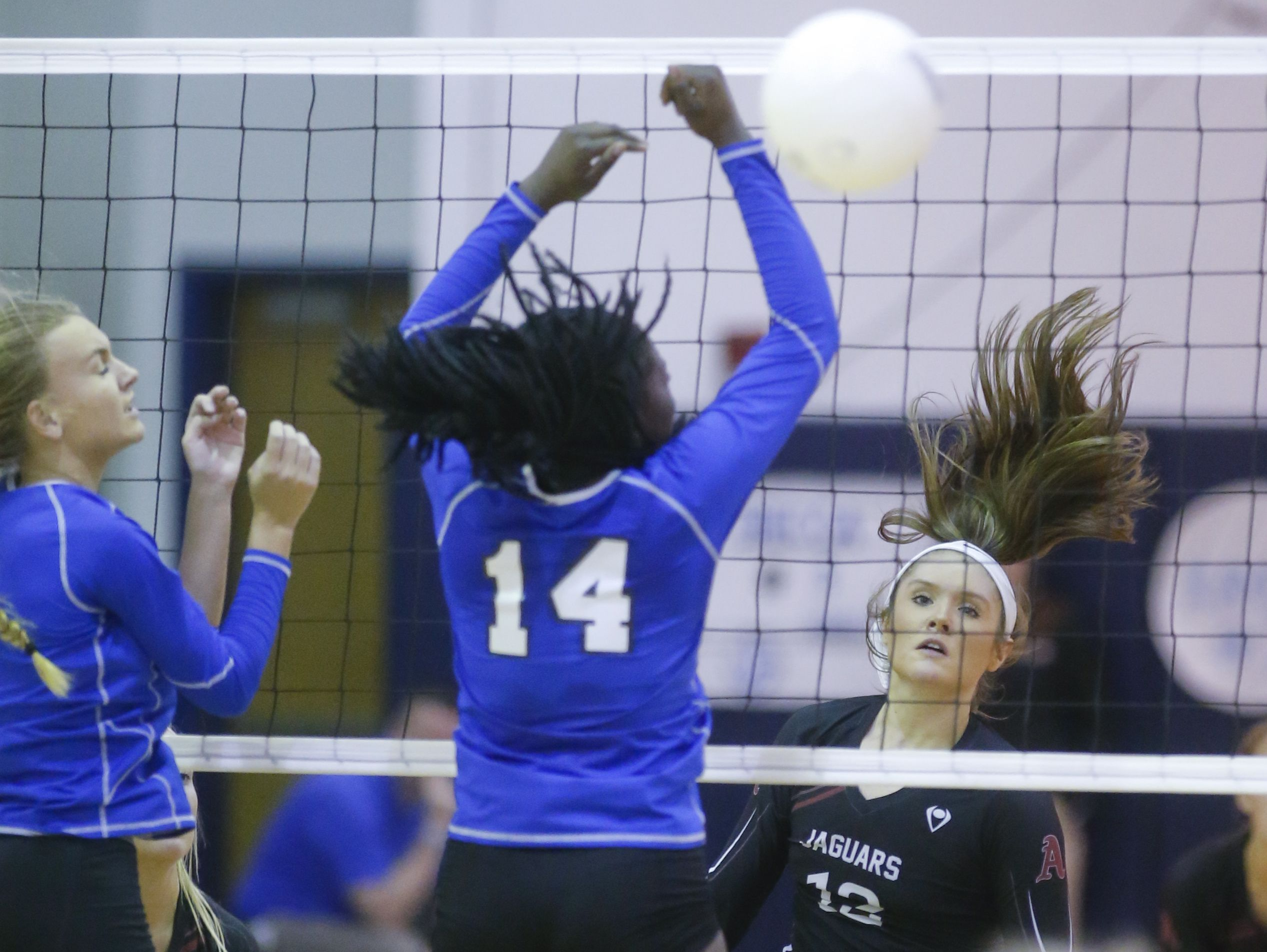 Appoquinimink's Carly Burns watches as a kill attempt gets past Middletown's Abigail Brooks (14) in the second game of the Jaguars' 3-0 win at Middletown High Wednesday.