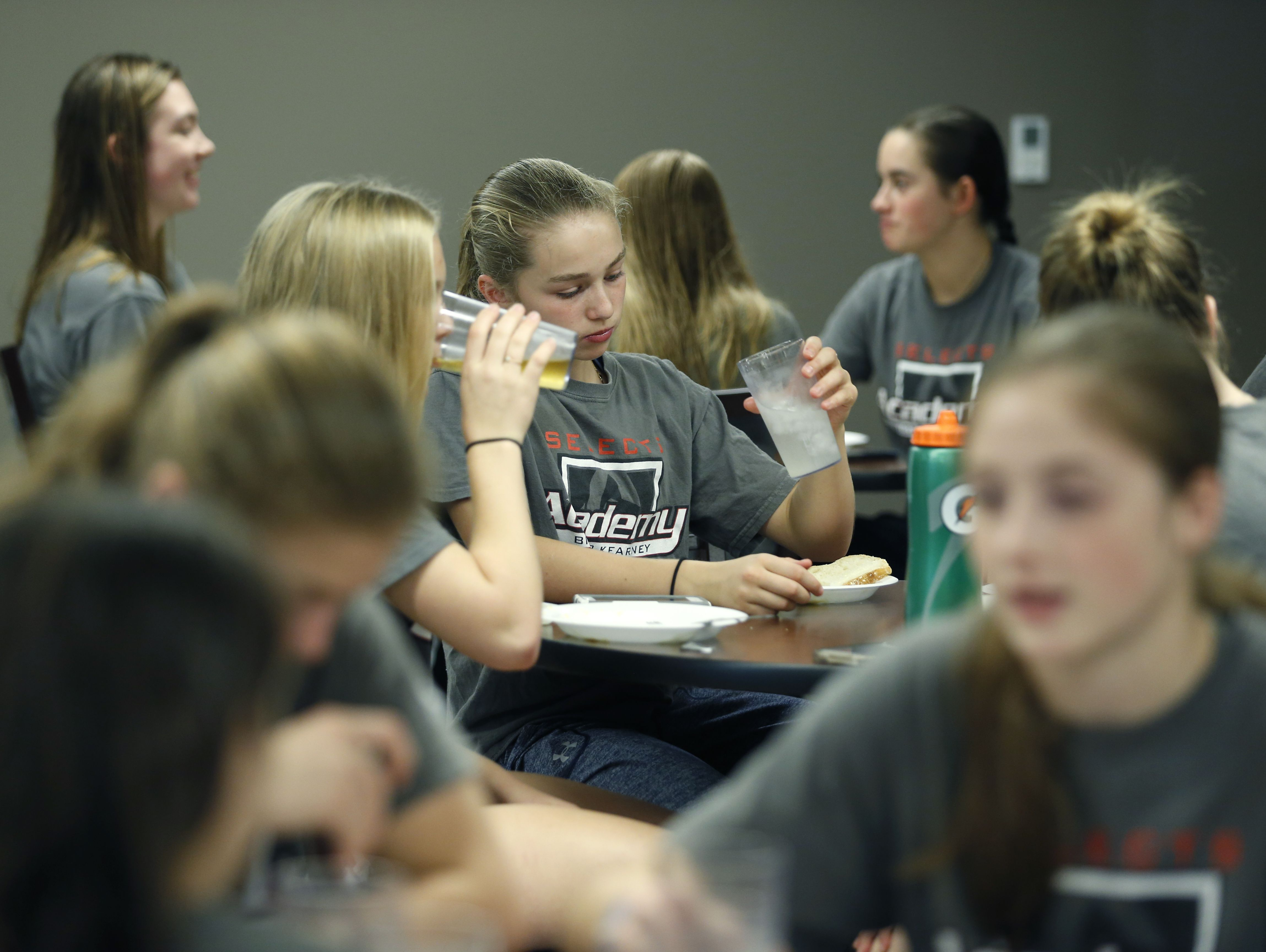 Caroline Harvey has dinner with her Bishop Kearney Selects Academy girls hockey teammates.