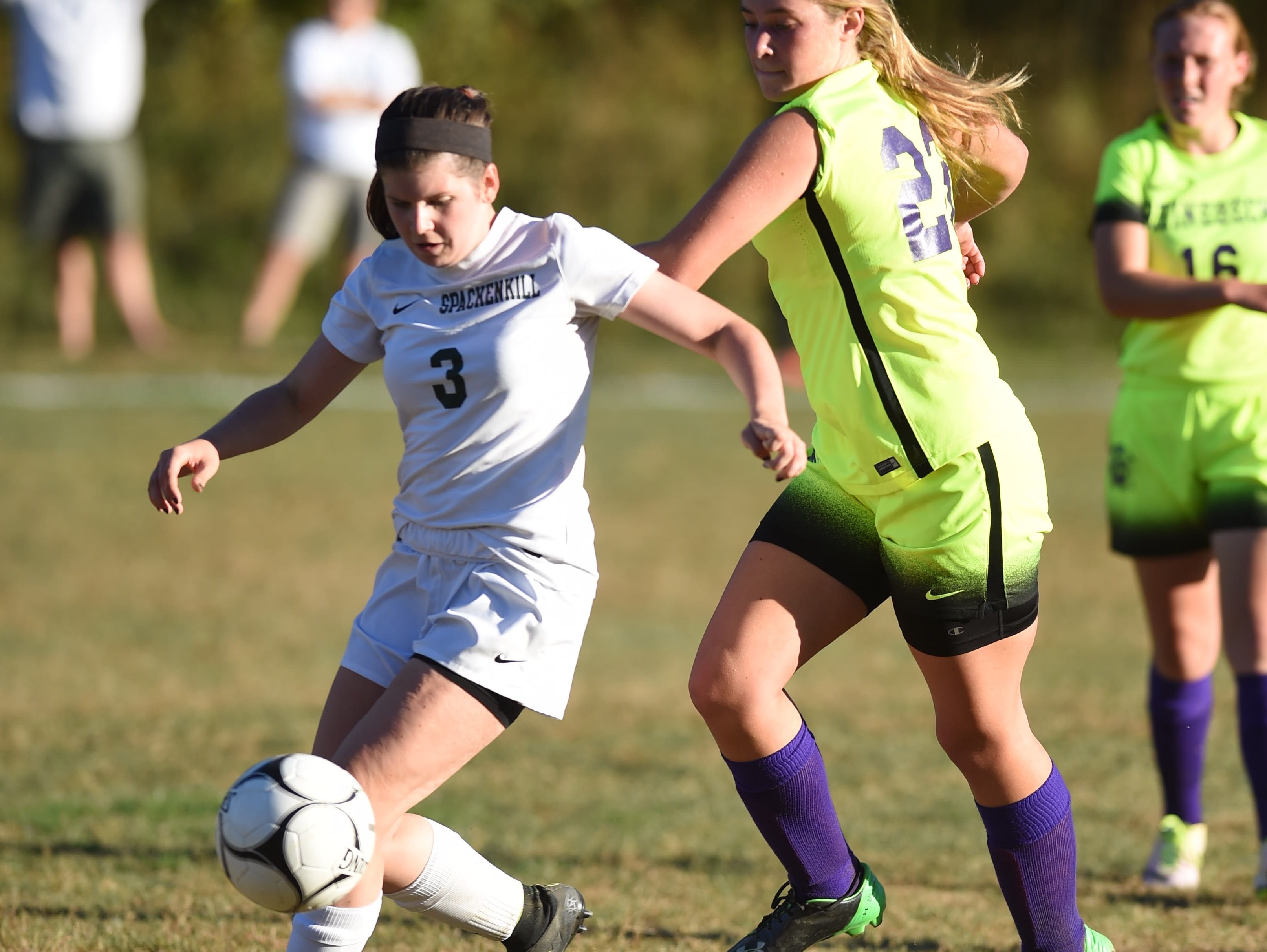 Spackenkill's Madison Cutler draws the ball away from Rhinebeck's Elizabeth Callahan during Thursday's game at Spackenkill.