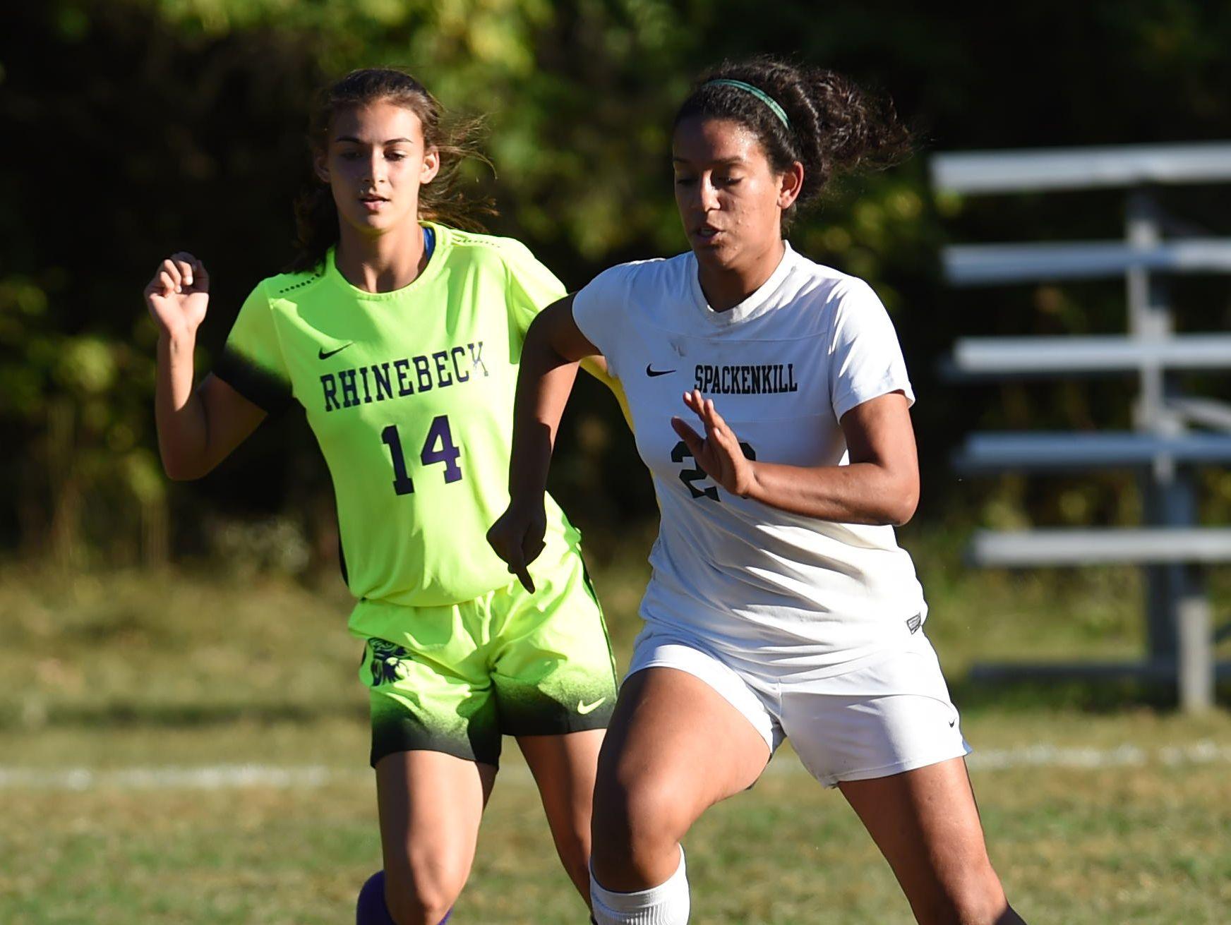 Spackenkill's Alyssa Barahona dribbles the ball away from Rhinebeck's Stephanie Cassens during Thursday's game at Spackenkill High School.