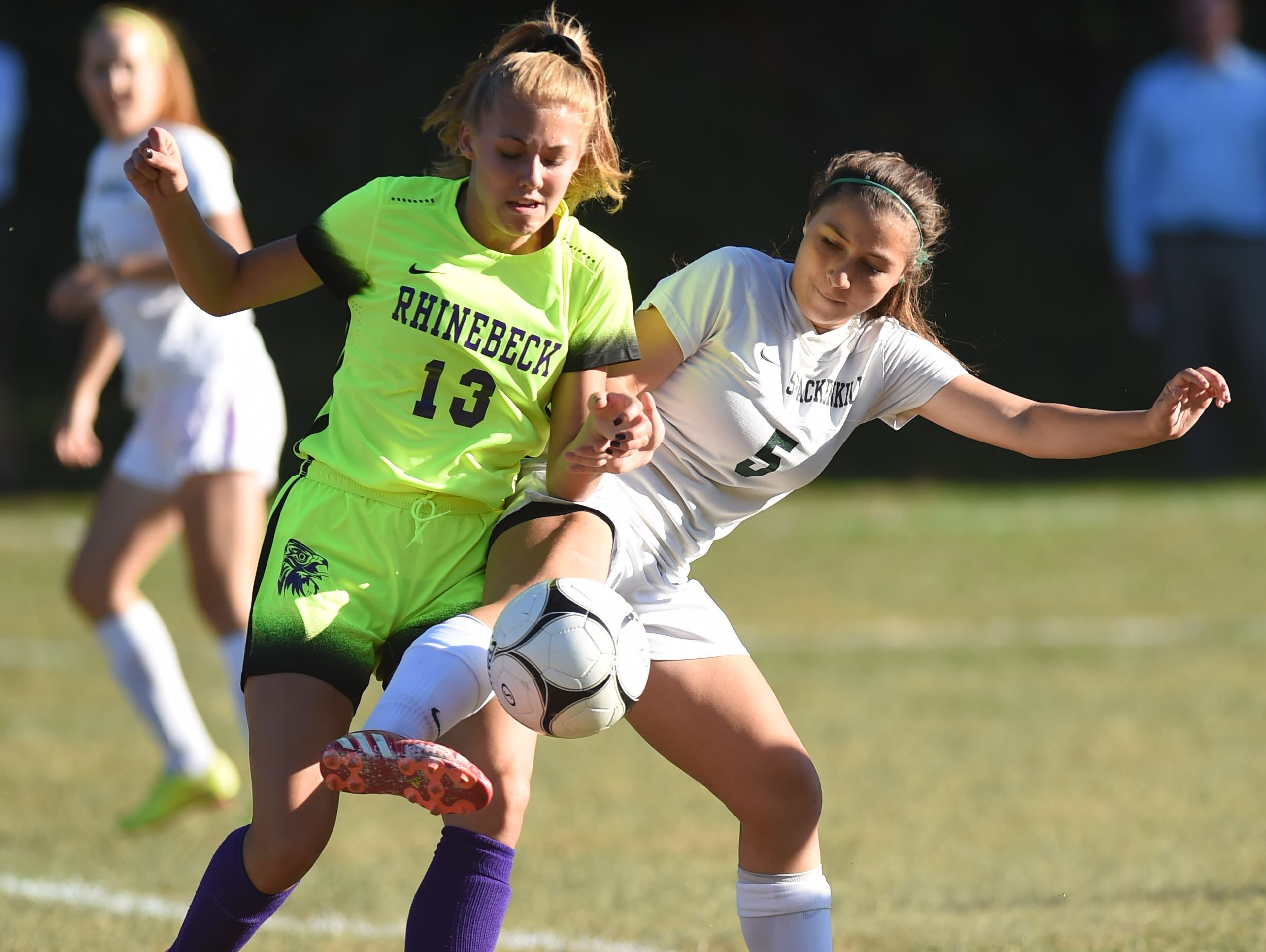 Spackenkill's Caitlin Speranza and Rhinebeck's Amber Hoglin battle for control of the ball during Thursday's game at Spackenkill High School.