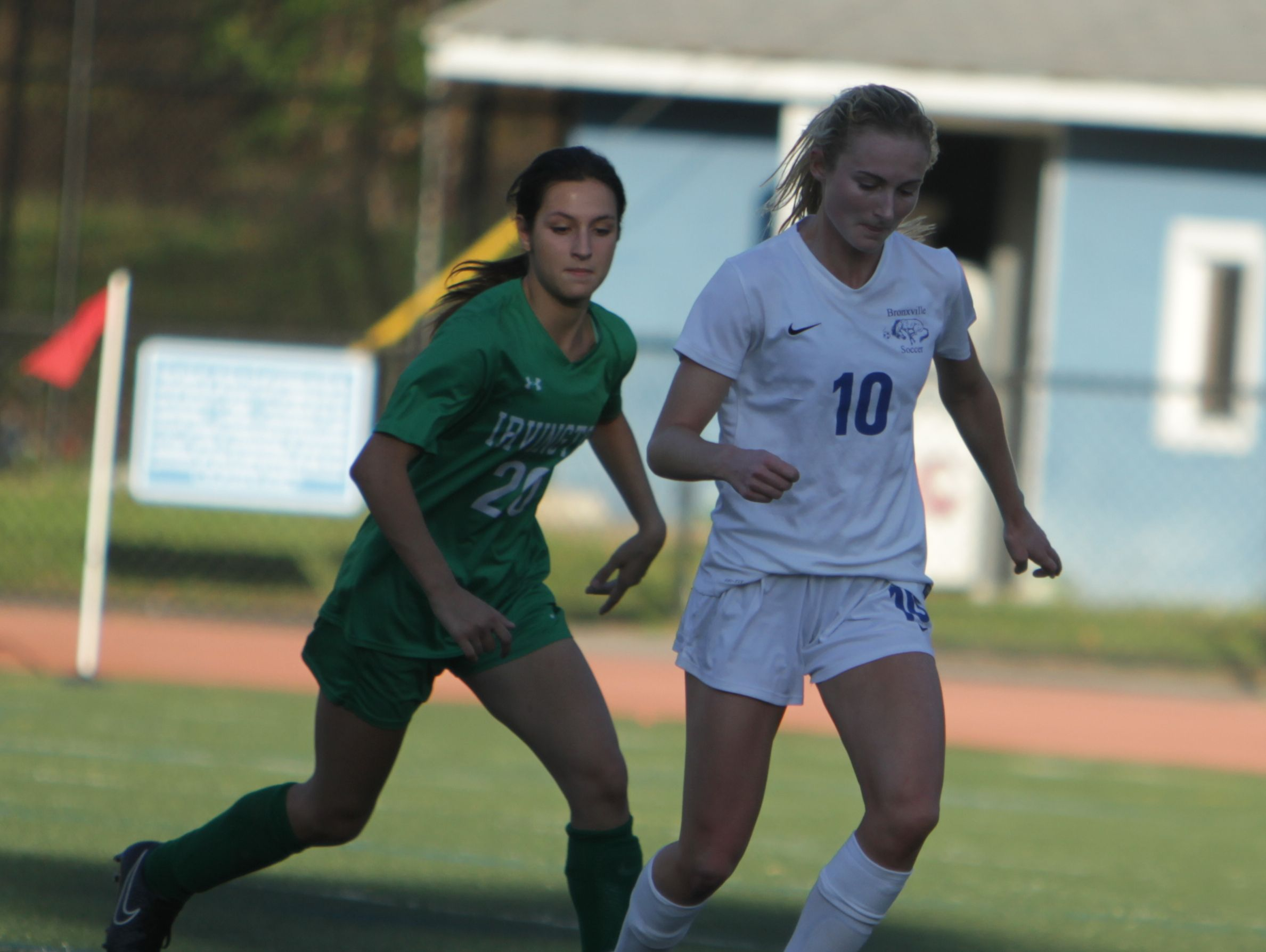 Bronxville's Mason Warble dribbles the ball while being watched by Irvington's Sofia Garcia during a Section 1 girls soccer game between Bronxville and Irvington at Bronxville High School on Thursday, Oct. 6th, 2016. Bronxville won 4-3.