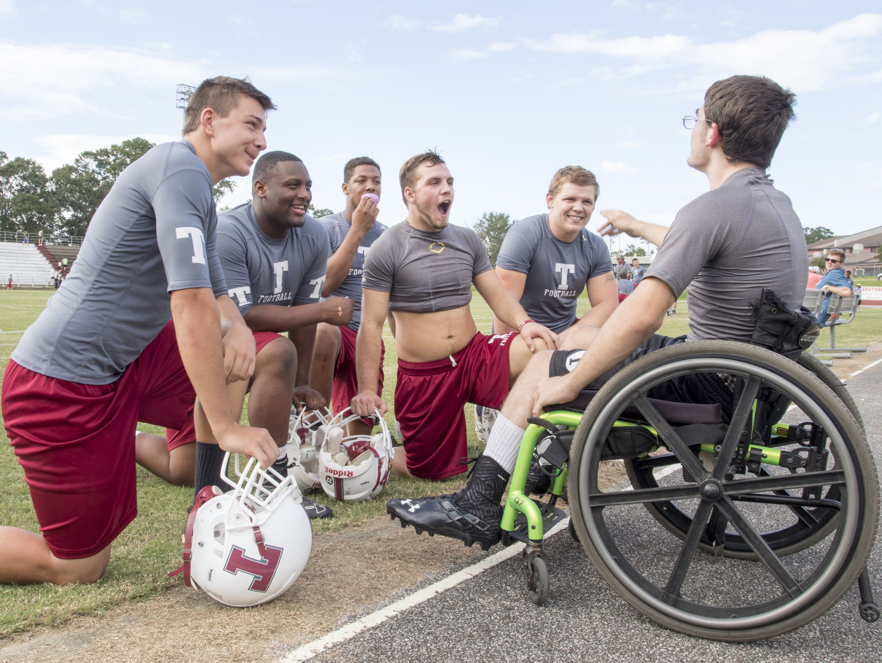 Markus Baxley, a student with cerebral palsy, has a laugh with some of his teammates during football practice at Tate High School in Pensacola on Thursday, October 6, 2016. Baxley will fulfill a lifelong dream when he participates in one play in the Friday night game against Pace High School.