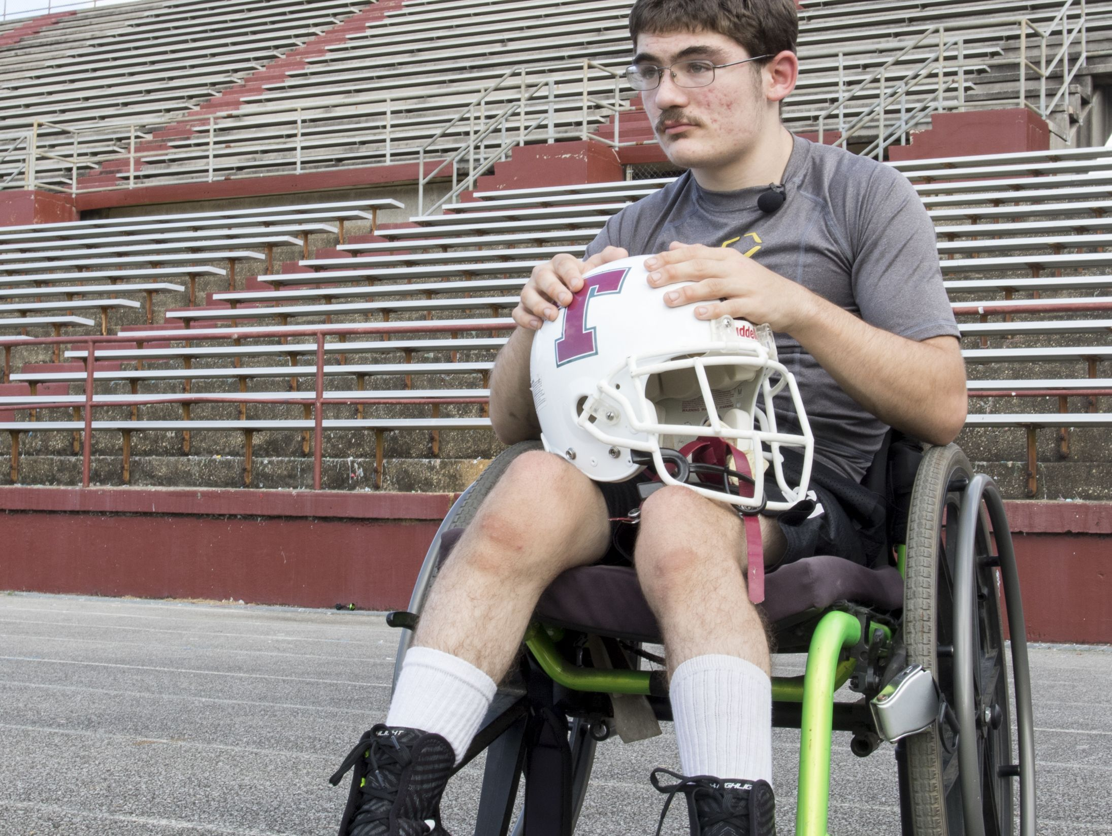 Markus Baxley, a student with cerebral palsy, watches his teammates during football practice at Tate High School in Pensacola on Thursday, October 6, 2016. Baxley will fulfill a lifelong dream when he participates in one play in the Friday night game against Pace High School.