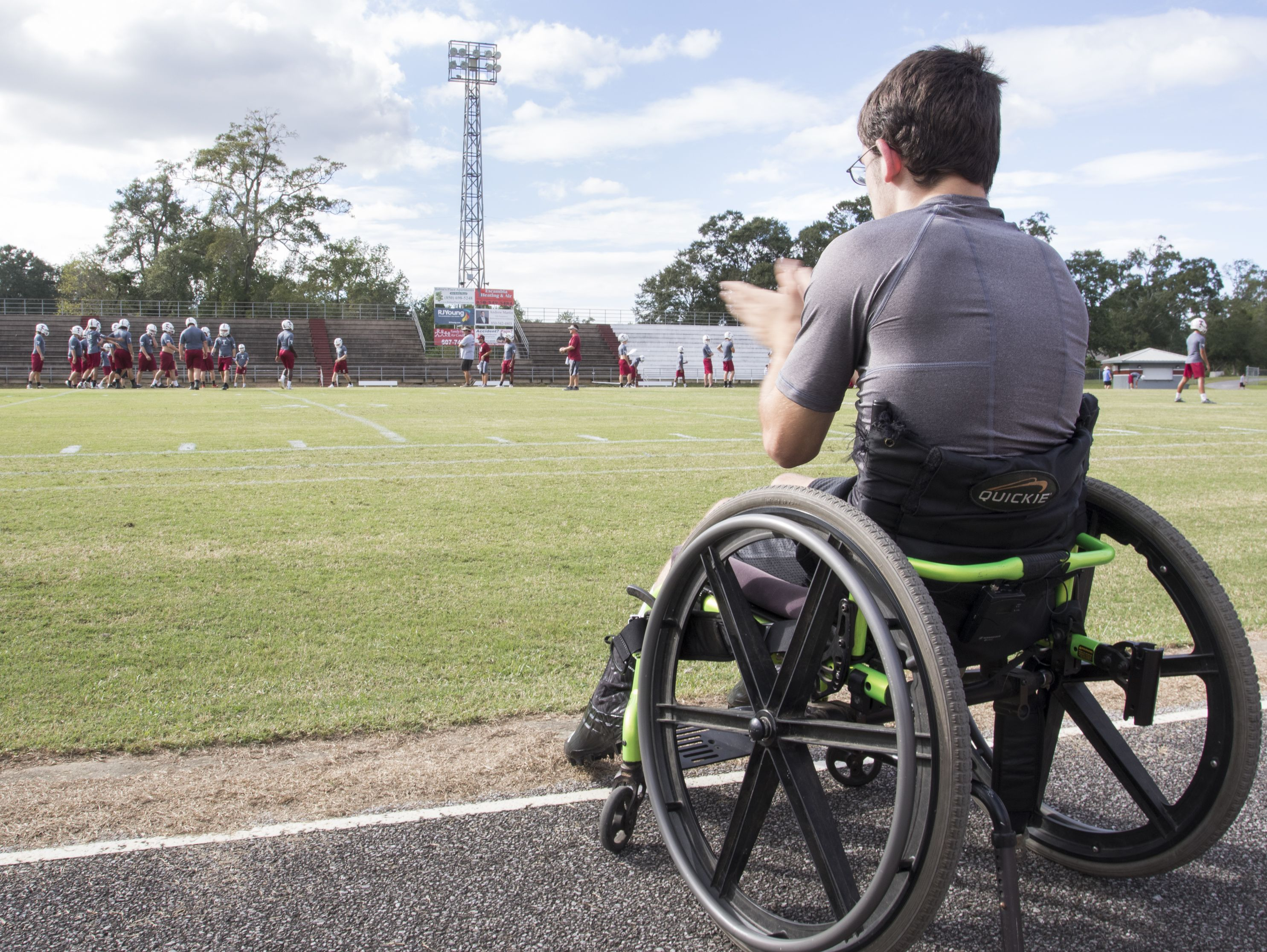 Markus Baxley, a student with cerebral palsy, cheers on his teammates during football practice at Tate High School in Pensacola on Thursday, October 6, 2016. Baxley will fulfill a lifelong dream when he participates in one play in the Friday night game against Pace High School.