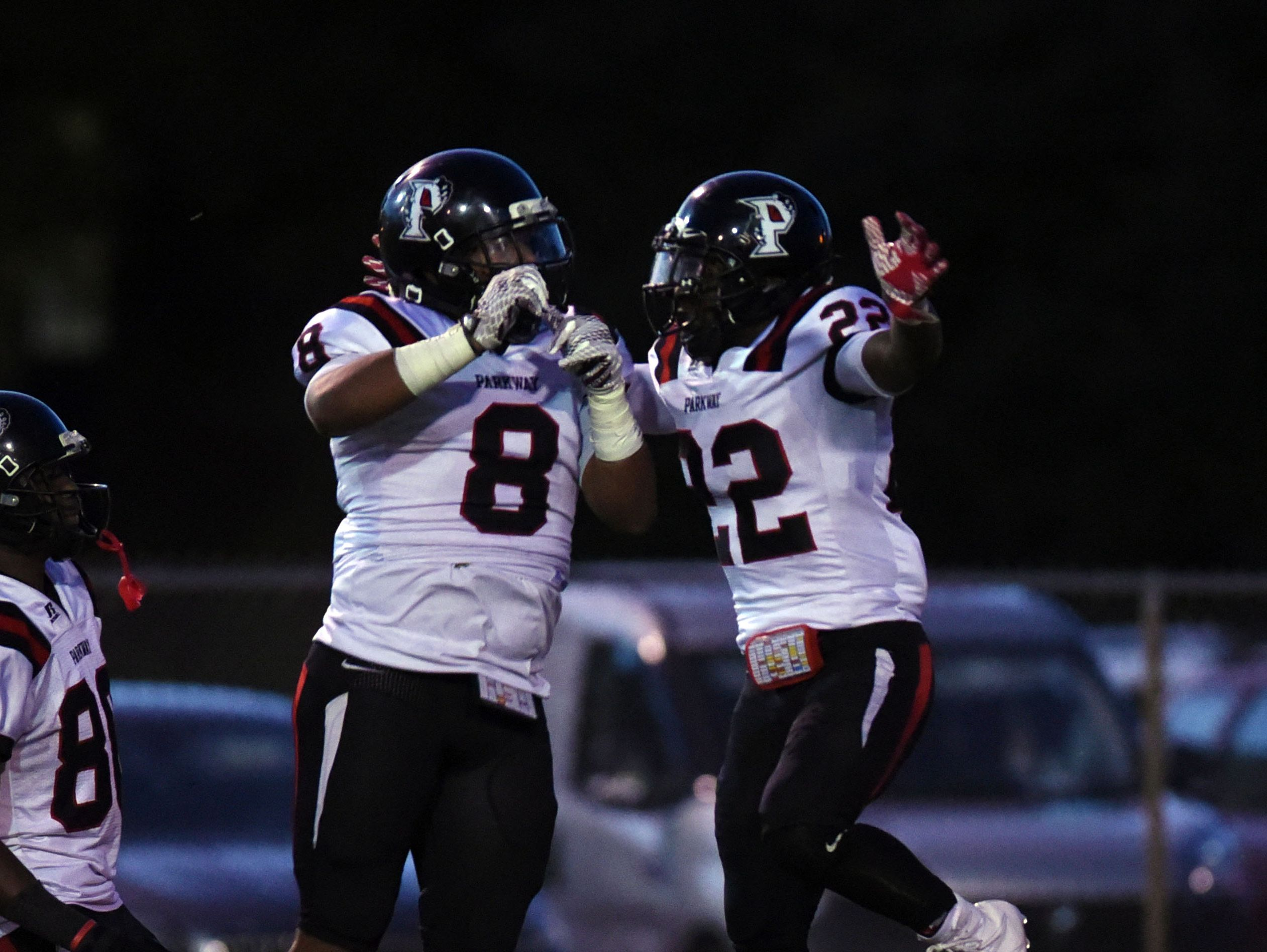 Parkway's Robert McKnight (22) celebrates his touchdown against Capt. Shreve during their District 1-5A game at Lee Hedges Stadium.