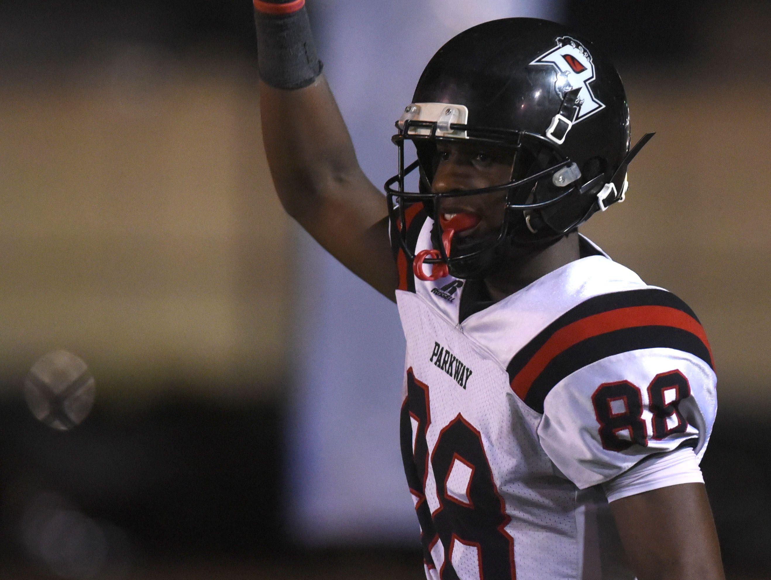 Parkway's Terrace Marshall celebrates a second quarter touchdown against Capt. Shreve in their District 1-5A game at Lee Hedges Stadium.
