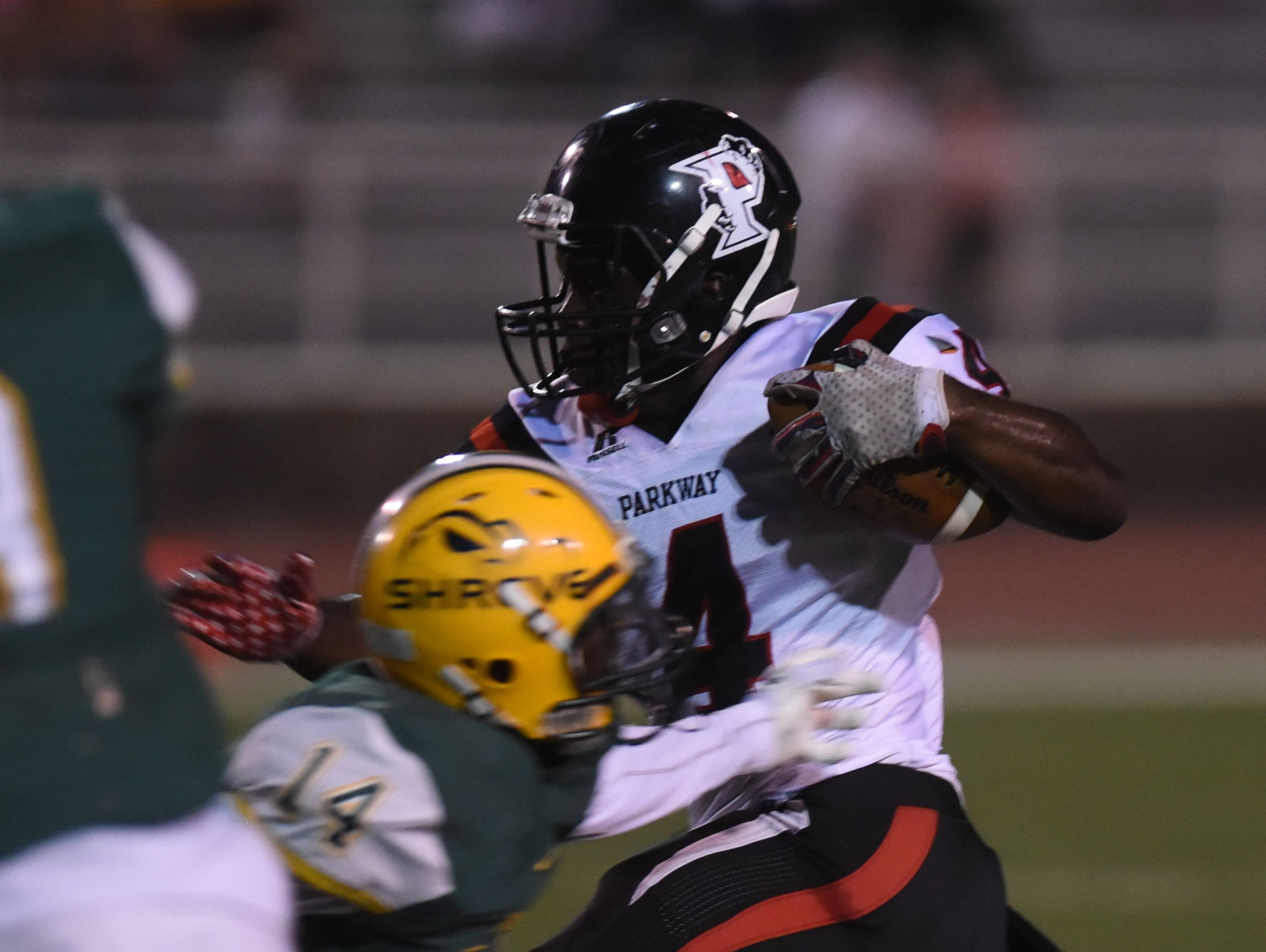 #4 EJ Williams cuts through the crowd for one of his two first half touchdowns against Capt. Shreve.