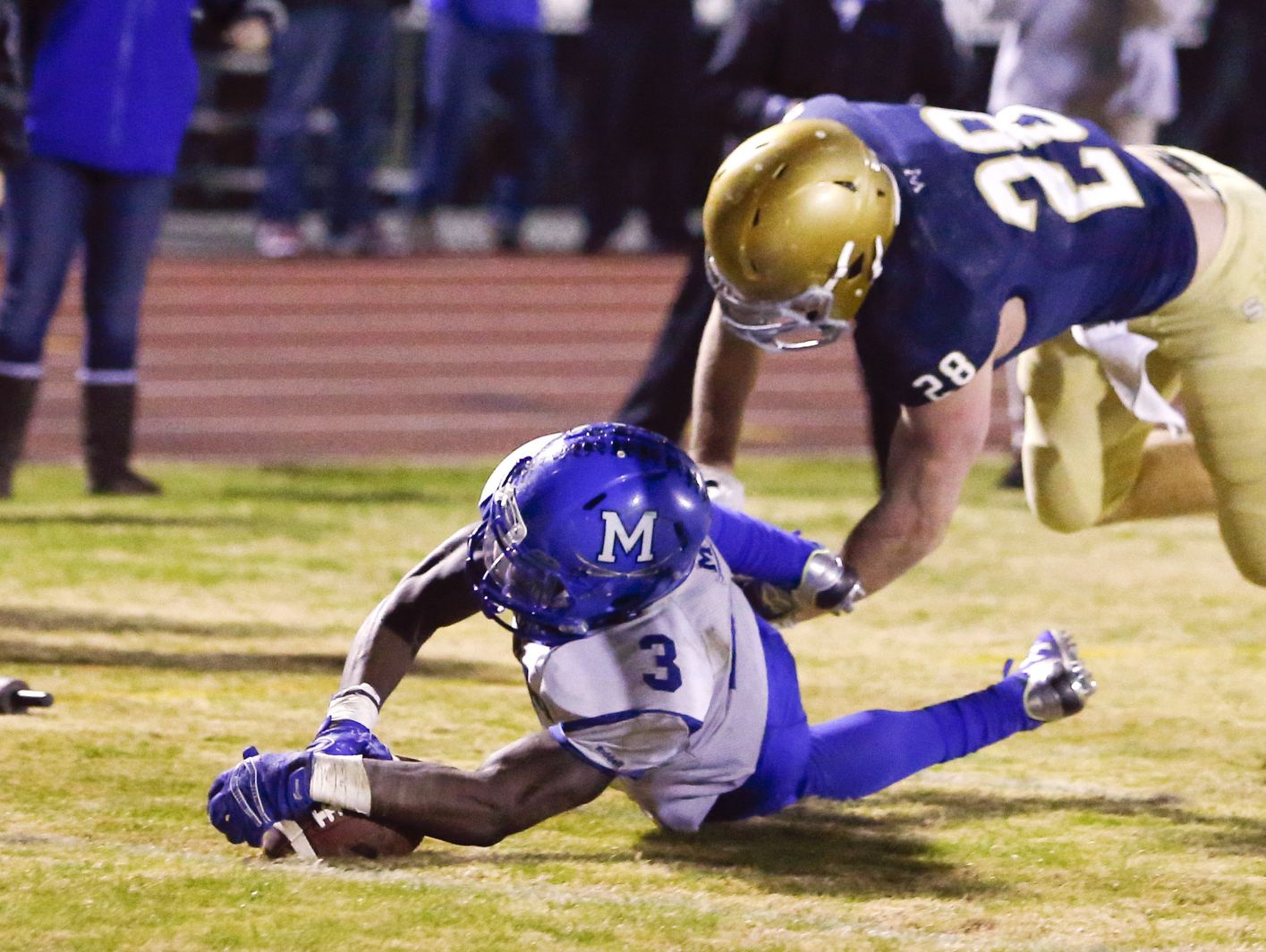 Middletown's Kedrick Whitehead (3) falls on his own fumble for a touchdown during last year's DIAA Division I state semifinal.