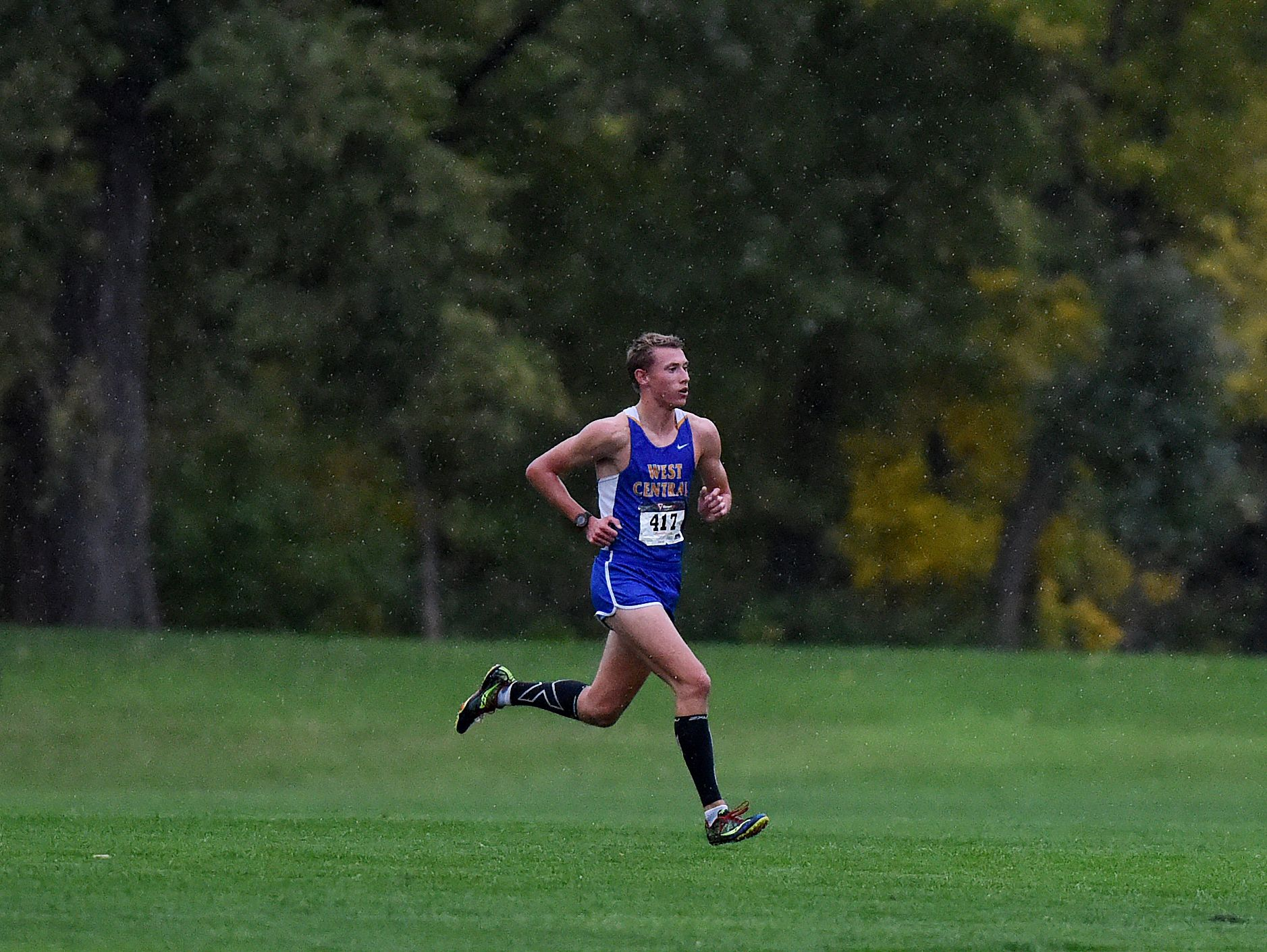 West Central's Derick Peters leads the way the Dakota XII Conference Meet at Yankton Trail Park on Thursday.