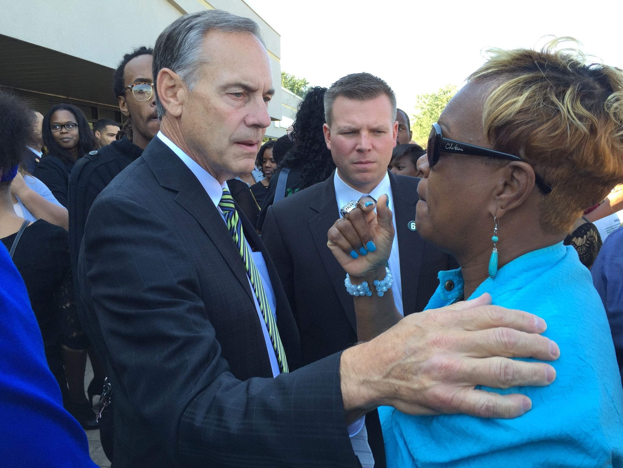 MSU coach Mark Dantonio with Mylan Hicks' mother, Renee Hill, at Friday's memorial service at New Providence Baptist Church in Detroit.