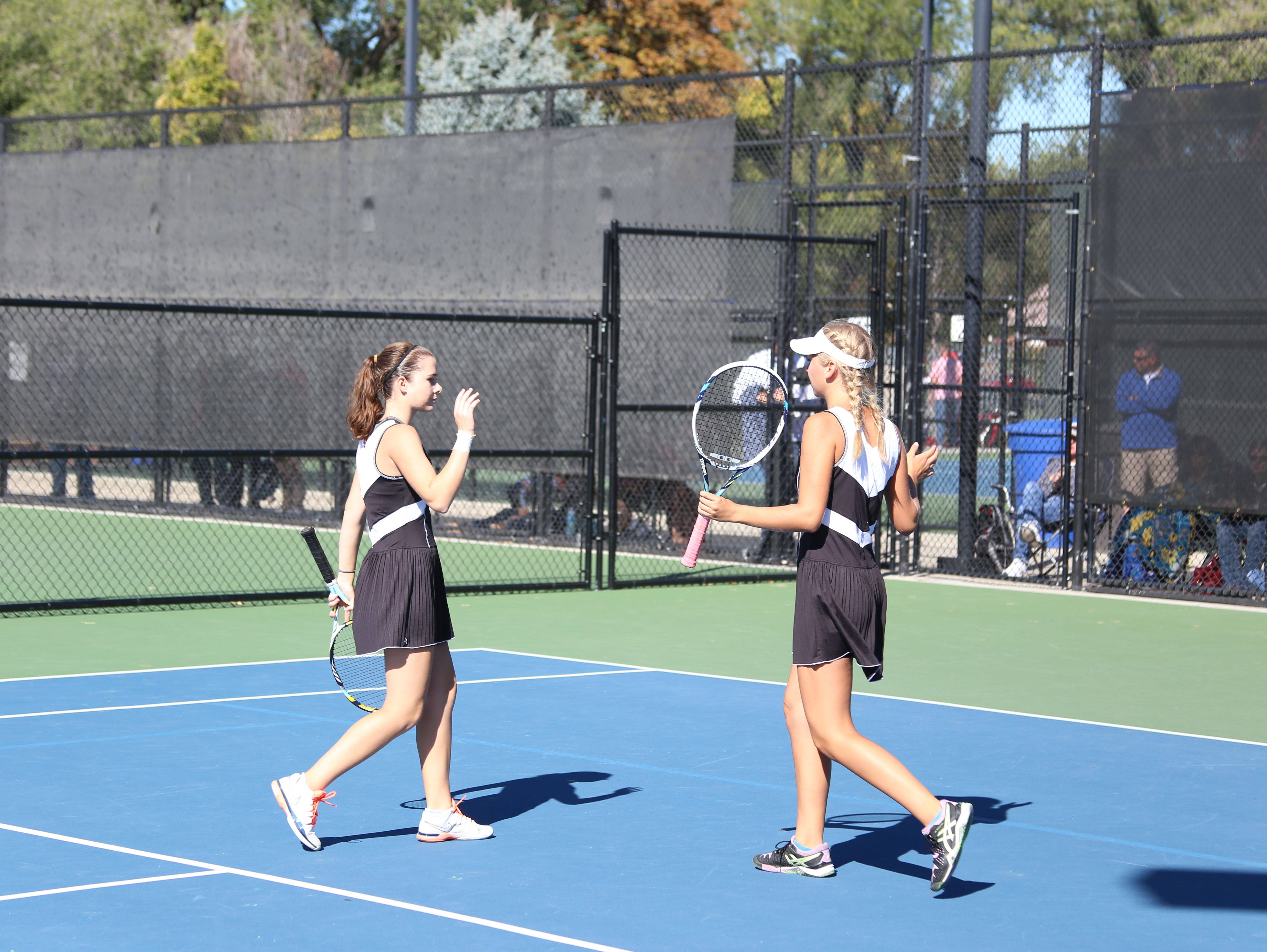Desert Hills' Lyndsi Graf and Jocelyn Kennedy celebrate after a point against Grantsville during the 3A state tournament at Liberty Park on Friday.