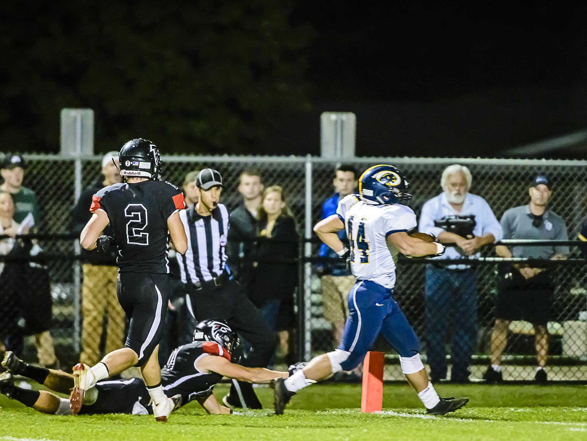 David Locher ,right, of DeWitt outruns Joey Kratzer ,bottom, of St. Johns for a touchdown midway through the 3rd quarter of their game Friday October 7, 2016 in St. Johns. The 1st down run from scrimmage put DeWitt up 18-7. KEVIN W. FOWLER PHOTO