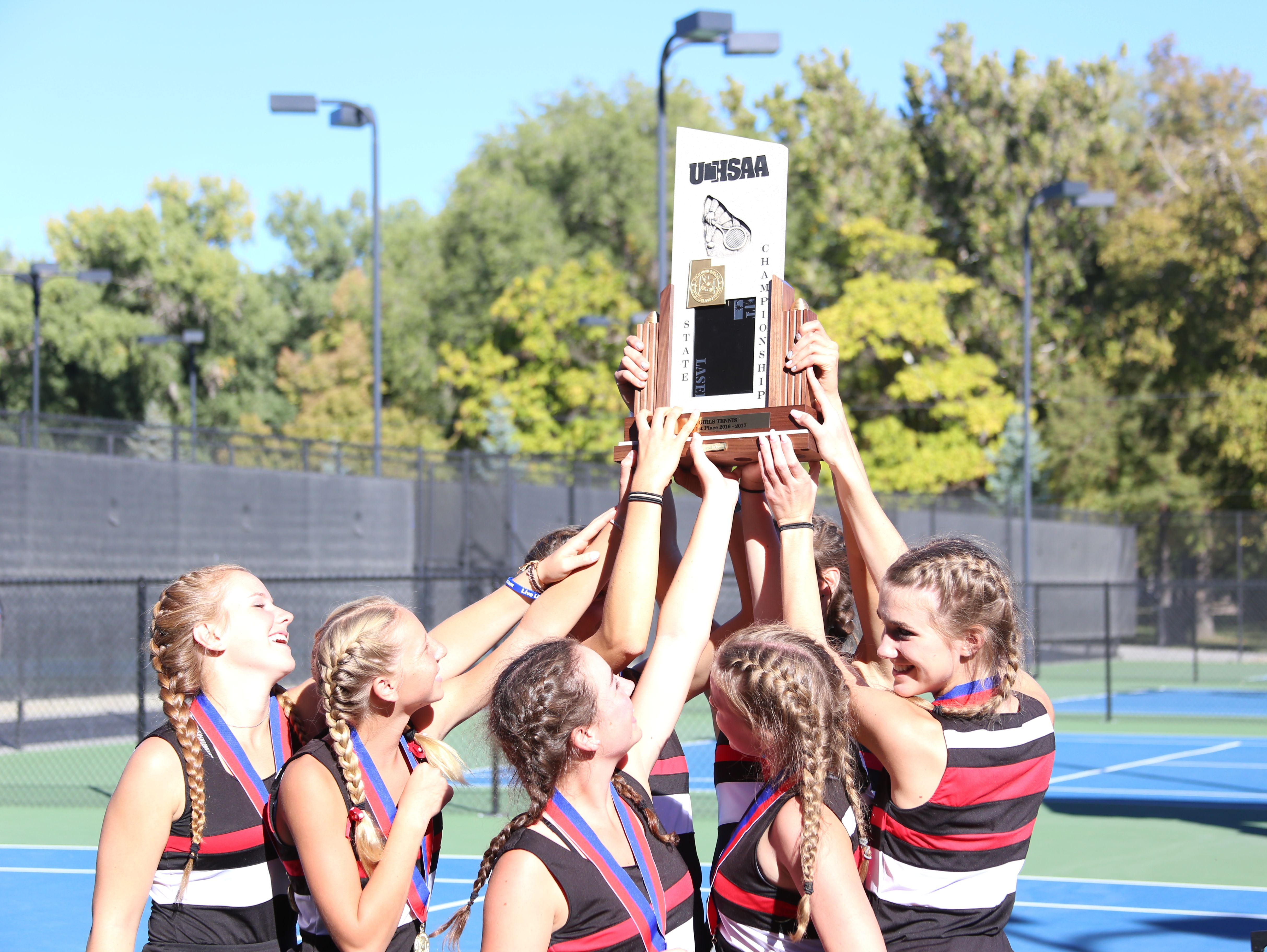 Park City celebrates after winning its second consecutive 3A state tennis title at Liberty Park on Friday.