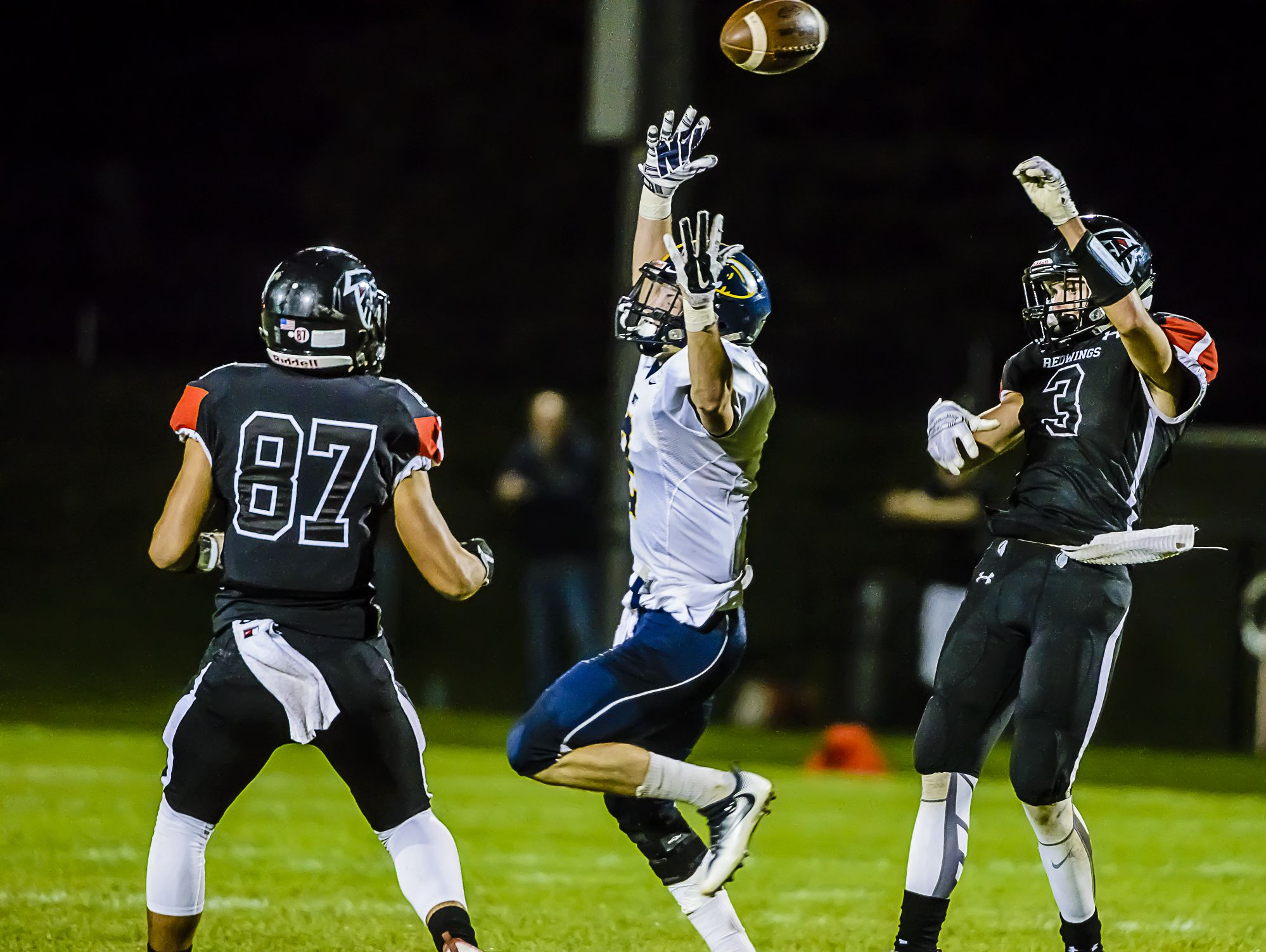 A pass meant for Beau Yabs ,center, of DeWitt is deflected right into the arms of St. Johns defender Hayden Dyer ,87, with 1:25 remaining in the 2nd quarter of their game Friday October 7, 2016 in St. Johns. KEVIN W. FOWLER PHOTO