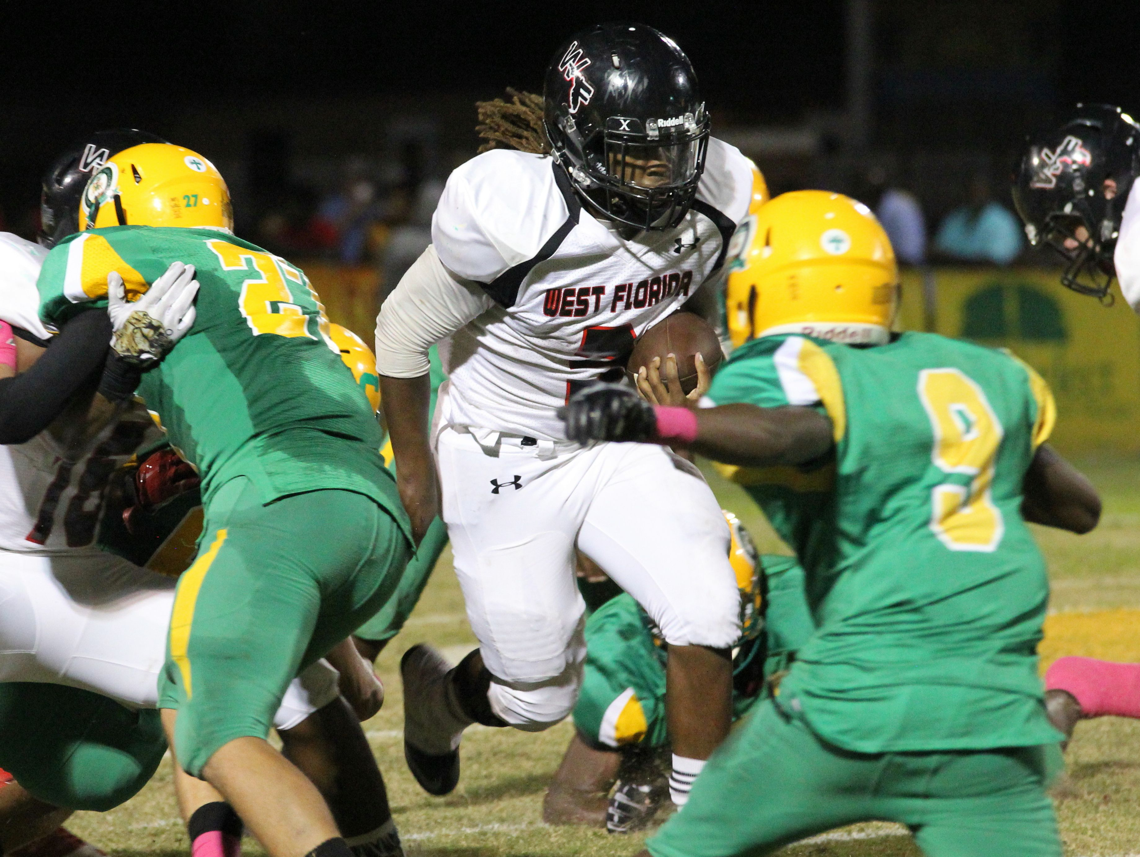 West Florida's Marquise Ross runs with the ball in the second quarter.