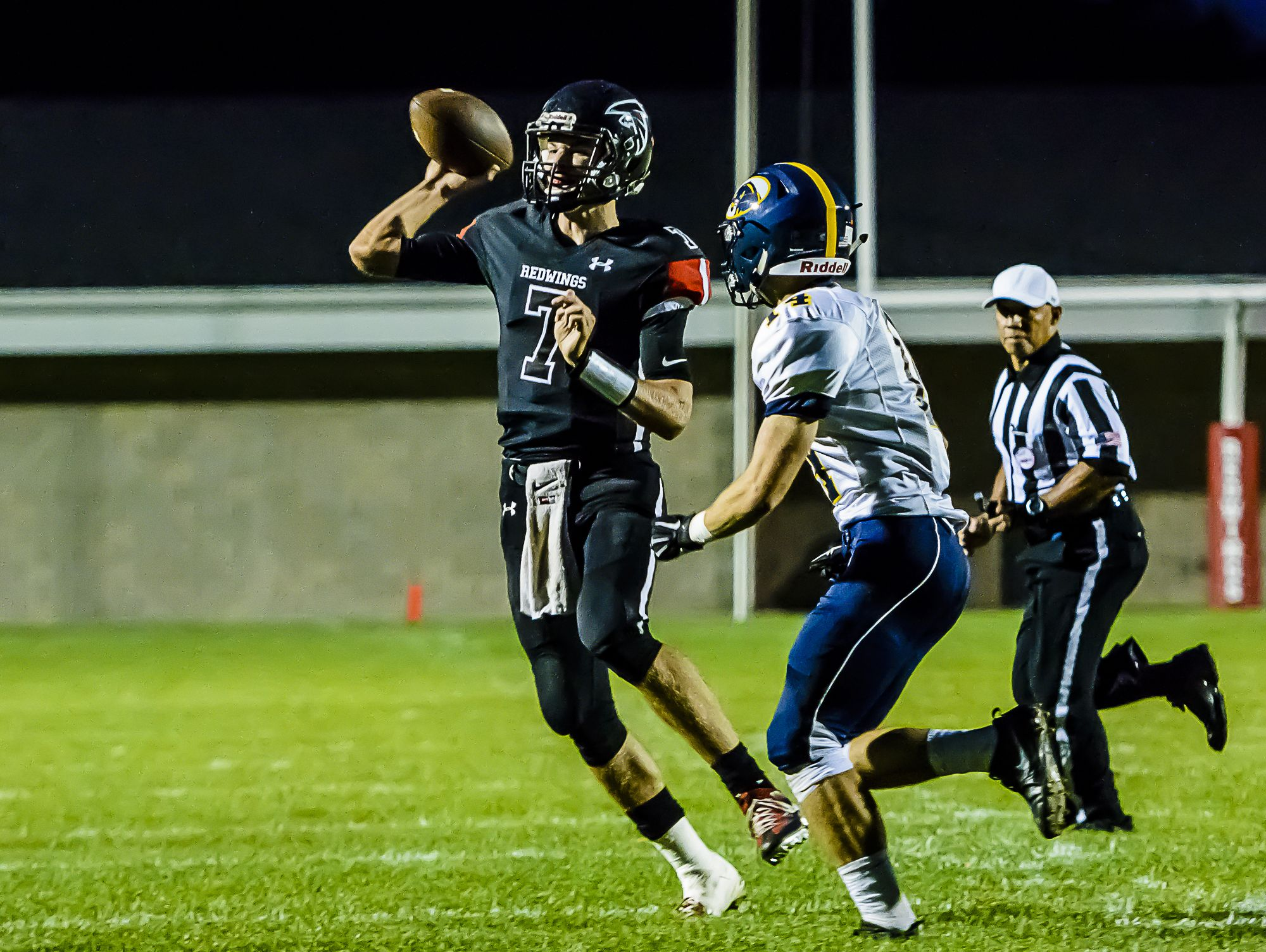 St. Johns quaterback Ross Feldpausch ,7, rolls out to pass into the endzone while being defended by Alan Smith of DeWitt early in the 2nd quarter of their game Friday October 7, 2016 in St. Johns. Feldpauschs' pass would fall incomplete. KEVIN W. FOWLER PHOTO