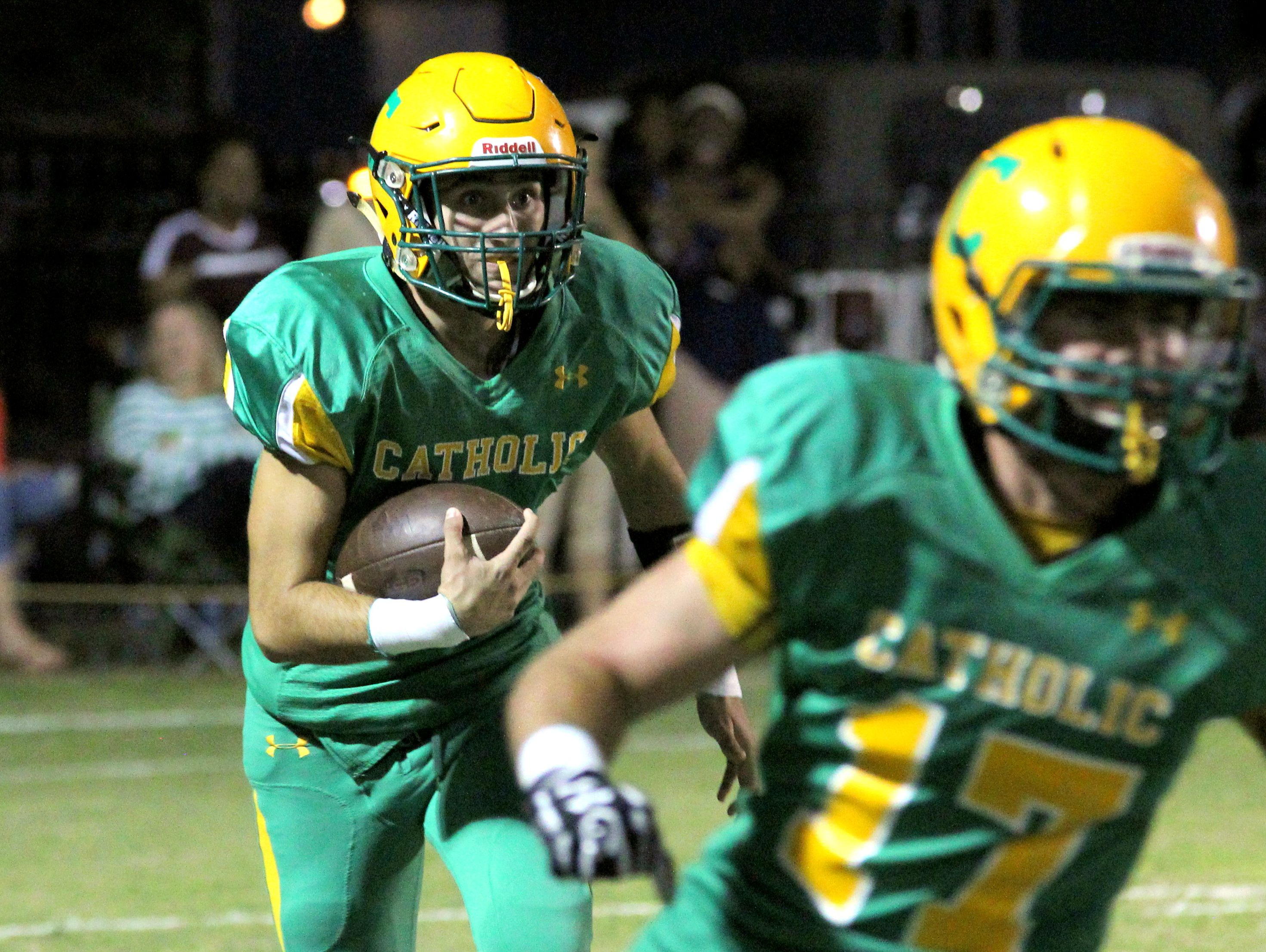 Catholic's A,J. Yates is wide-eyed as he returns a kickoff in the first half.