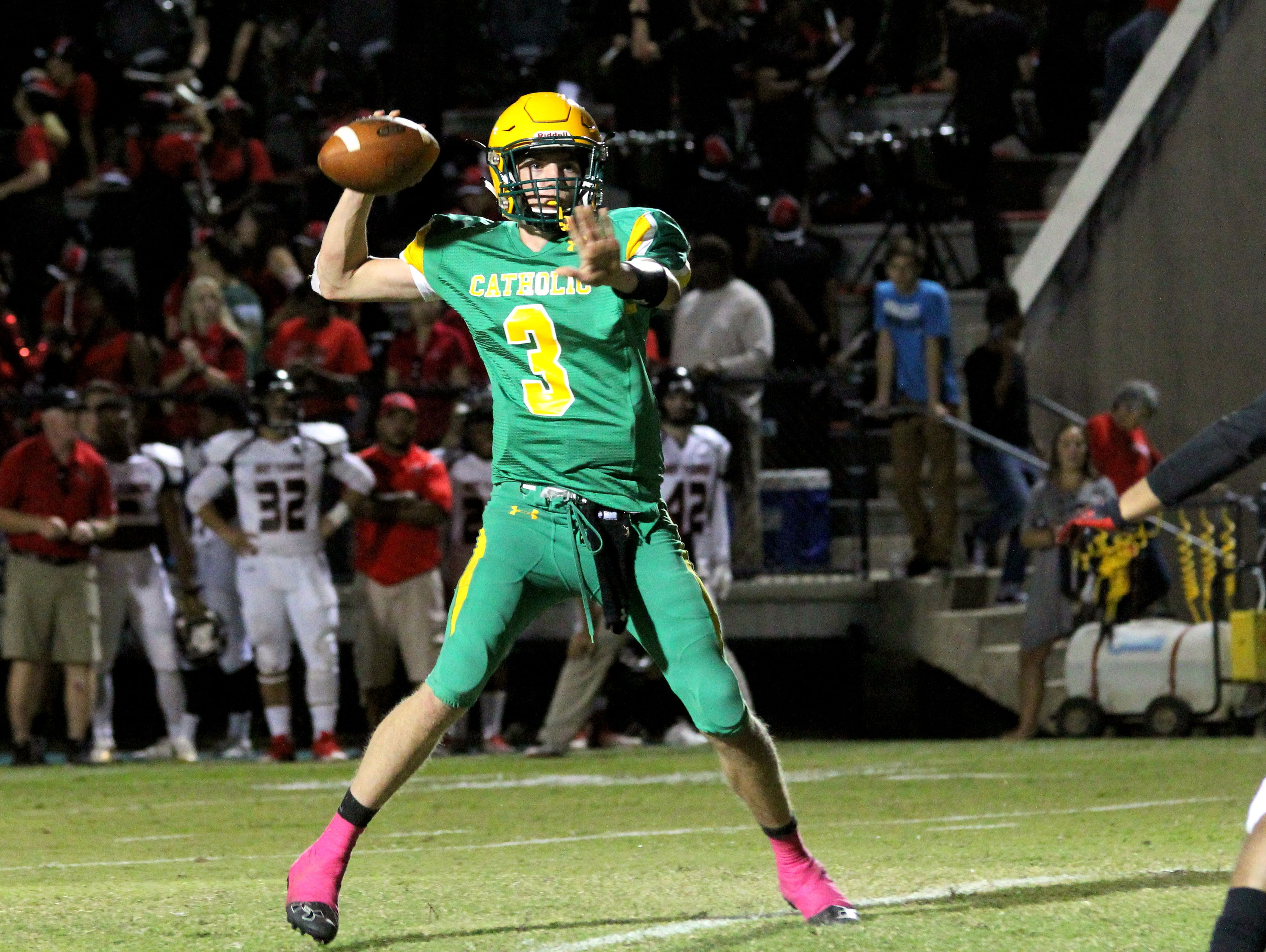 Catholic's Garrett Foley is set to pass during the Crusader's fourth-quarter TD drive.
