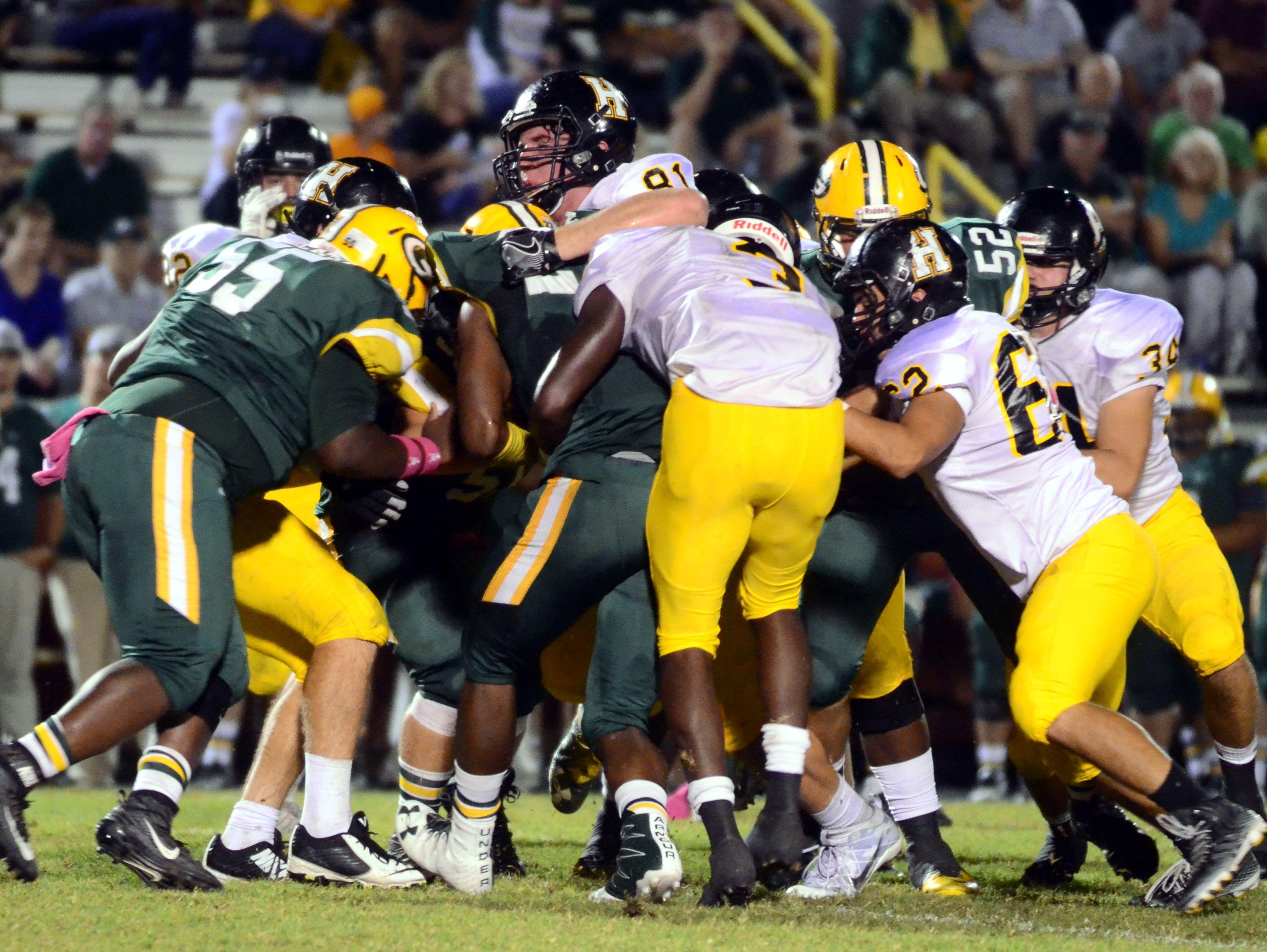 Hendersonville senior Jordan Amis (81) helps push the pile to tackle Gallatin senior Jordan Mason during Friday's game.