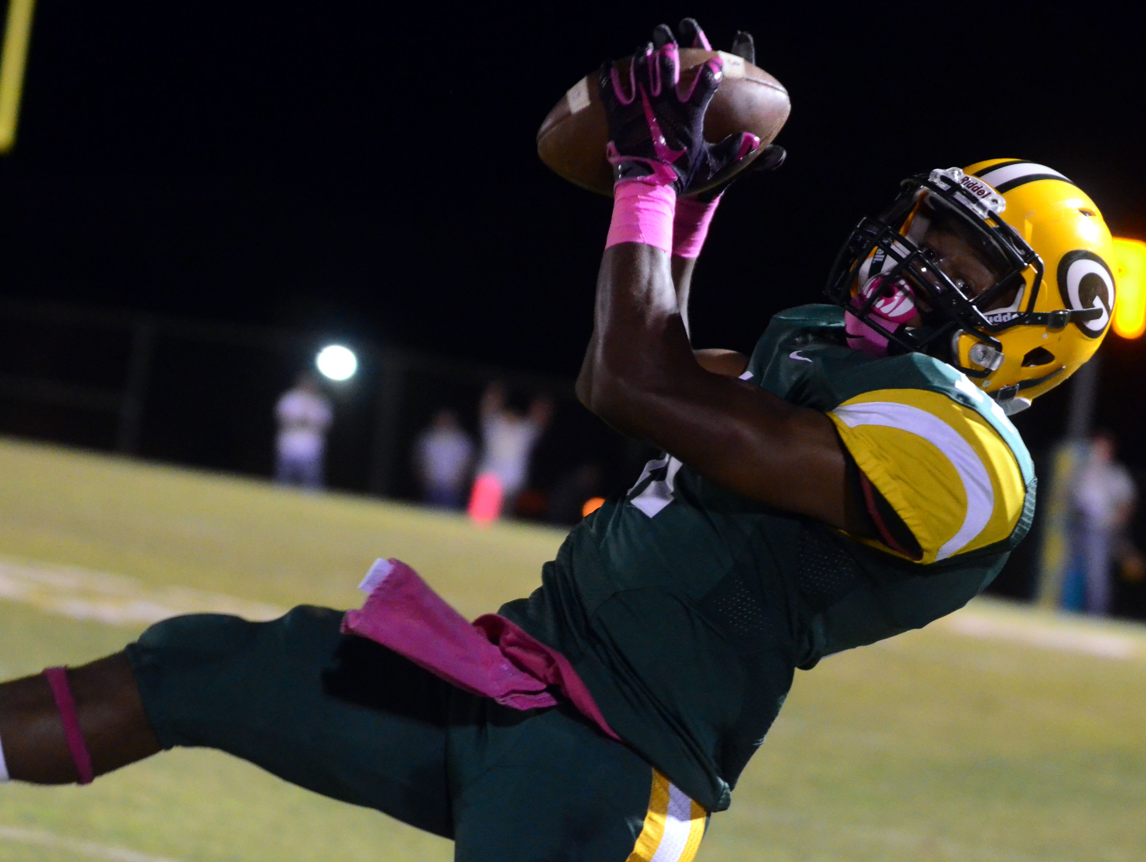 Gallatin senior Dezmond Chambers goes airborne to haul in a pass on the sideline, though it was ruled incomplete during Friday's 49-20 victory over Hendersonville.
